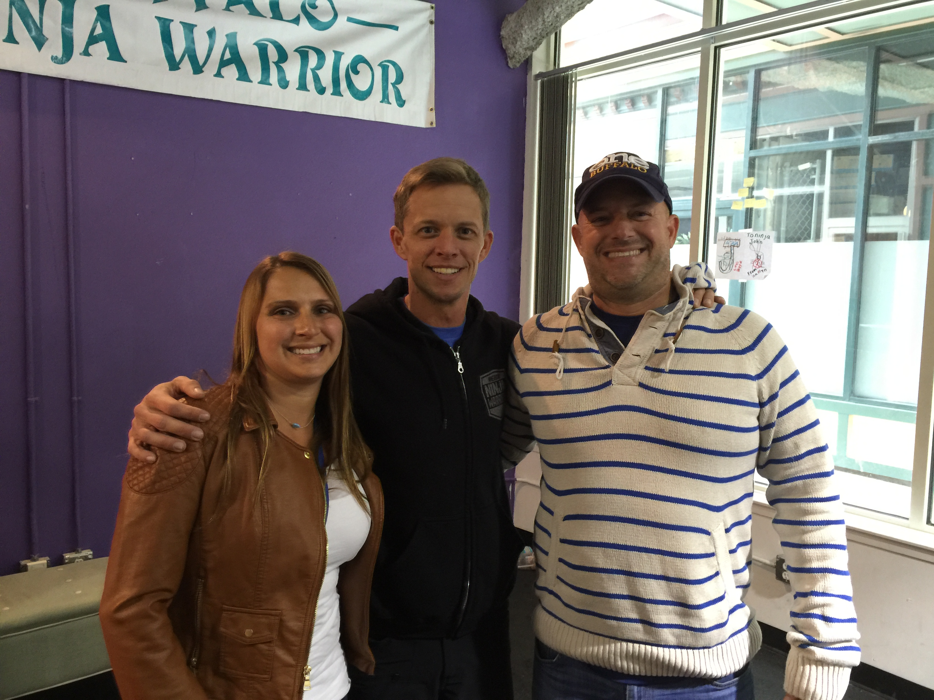 Tara and Adam Martin flank Geoff Britten Saturday during Buffalo Ninja Warrior 6. Britten thanked Adam Martin for starting a Go Fund Me campaign after a controversial ending of last season's 'American Ninja Warrior' TV show.