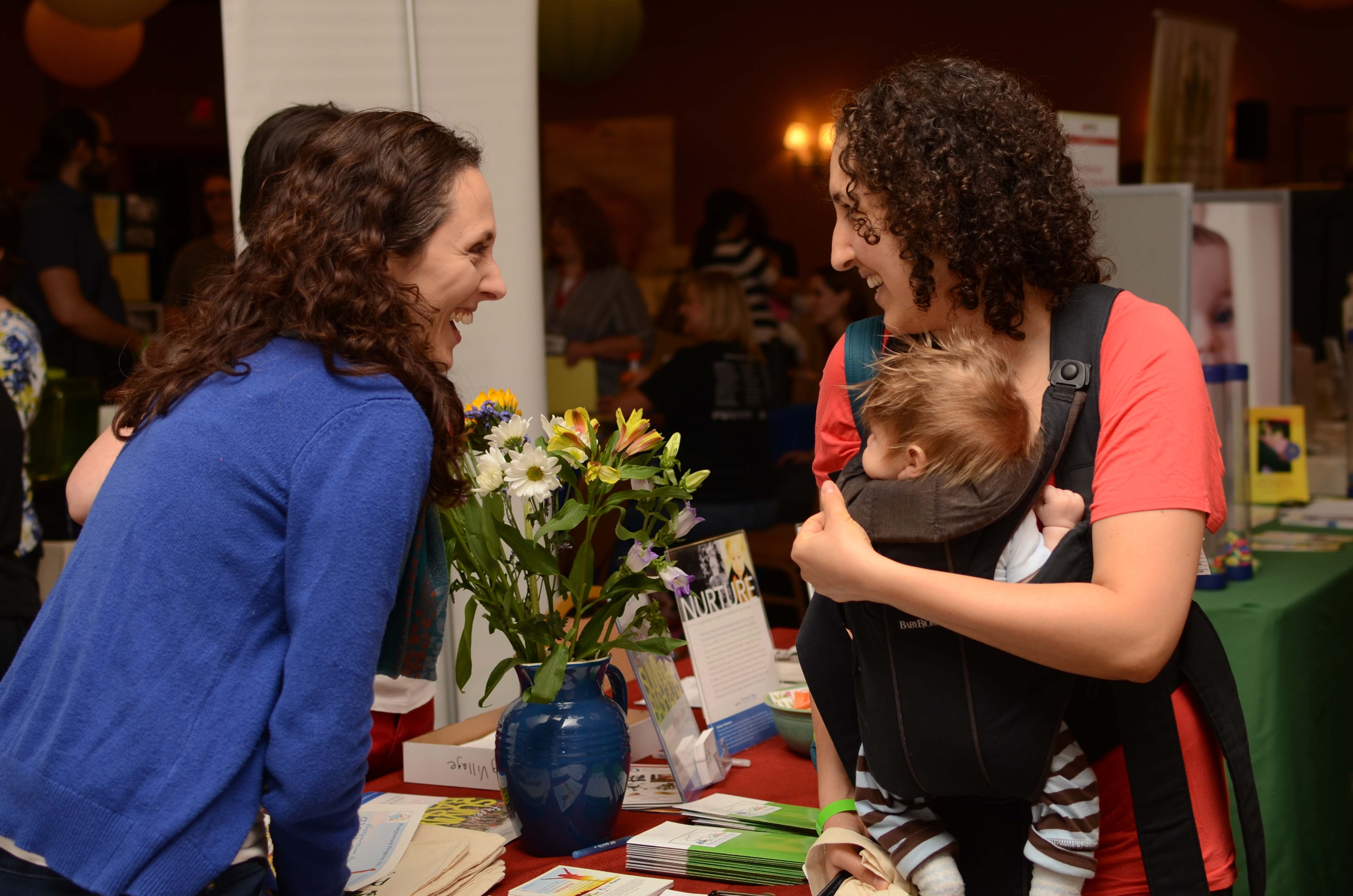 Emily Horowitz, left, from Parenting Village in Rochester, has been among the exhibitors at Beyond the Bump programs in that city. Beyond the Bump comes to Buffalo Saturday for the first time.