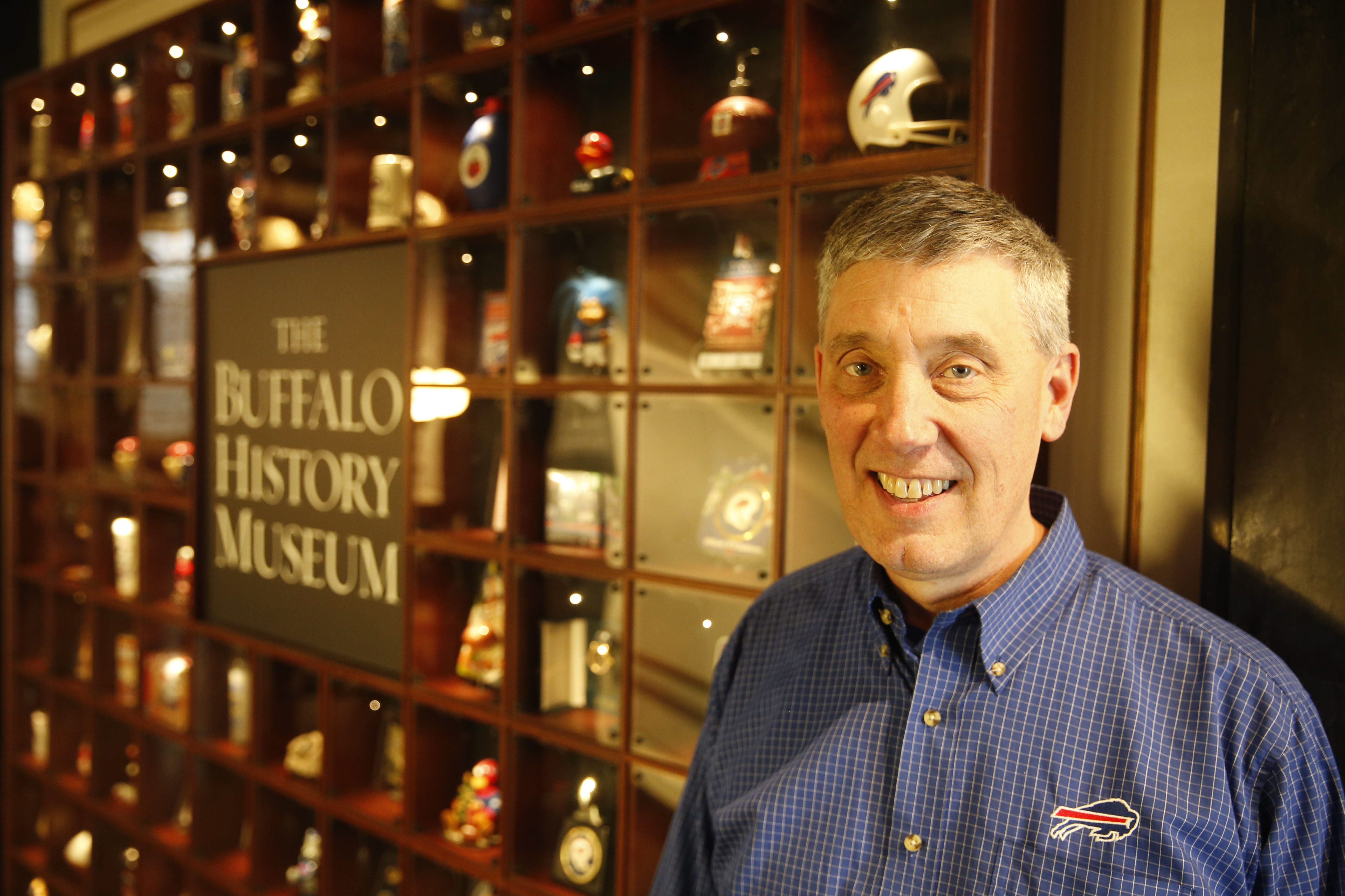 Bills fan and super collector Greg Tranter with some of his collection that he donated to the Buffalo History Museum.  (Derek Gee/Buffalo News)