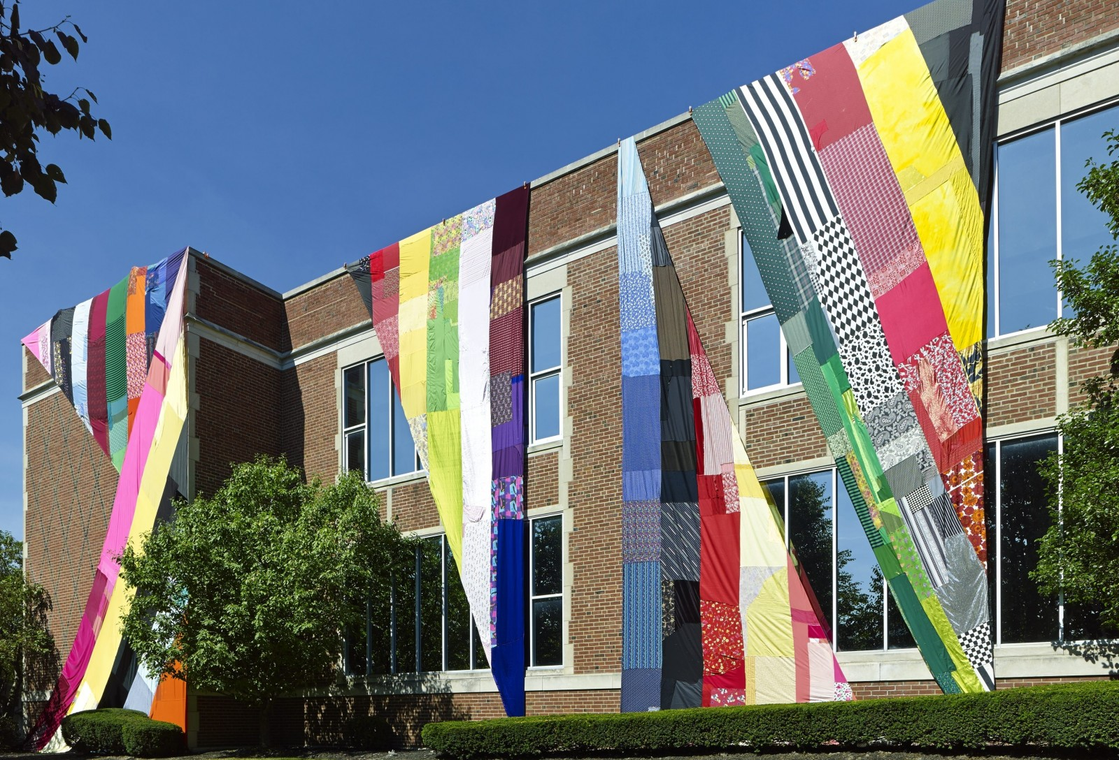 "Amanda Browder's fabric installation ""Prismatic Illusions"" hung on the exterior of the University at Buffalo Anderson Gallery in September before moving to the lightwell gallery in UB Art Gallery in October 2015."