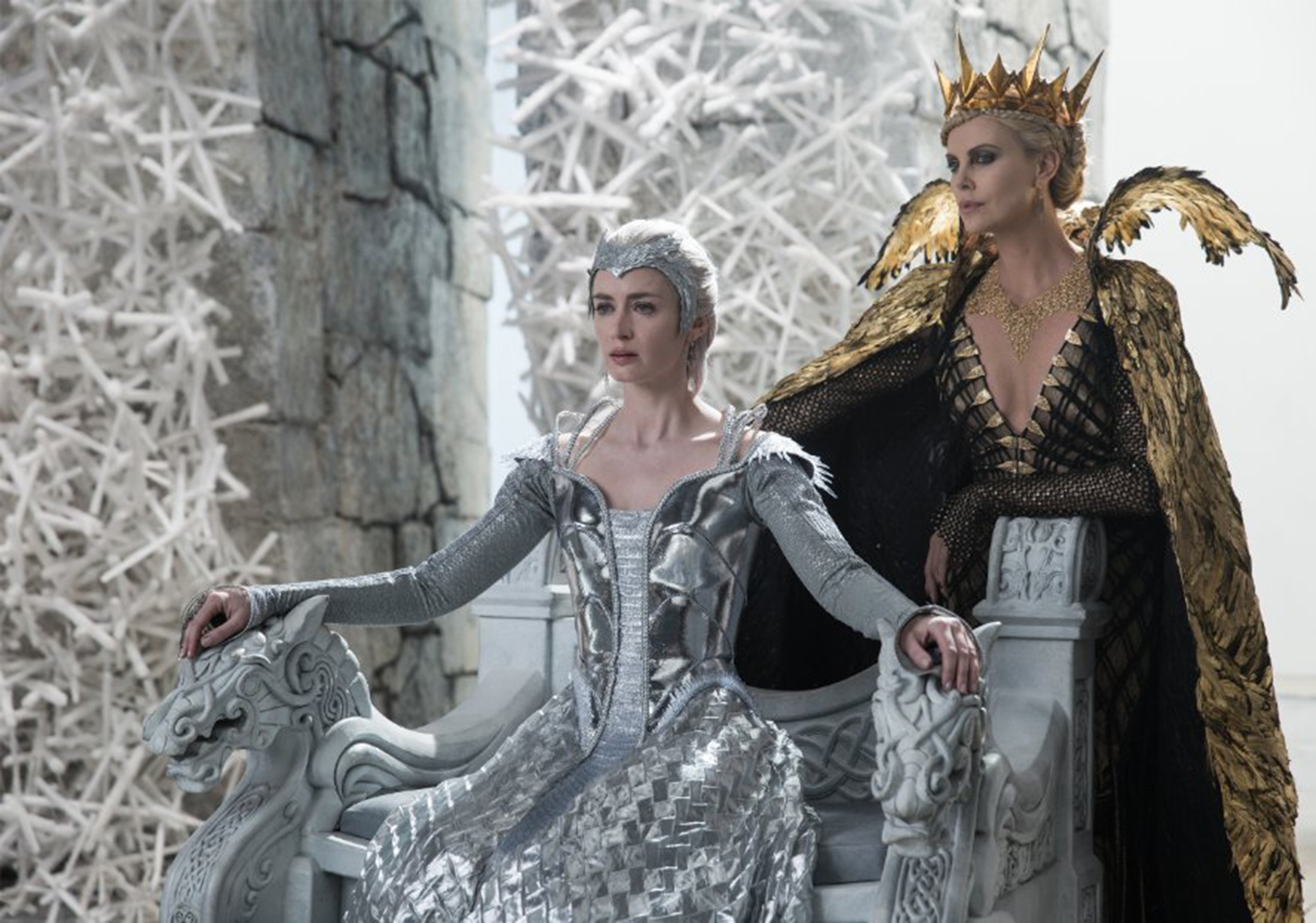 "Emily Blunt, left, and Charlize Theron star in ""The Huntsman: Winter's War."""