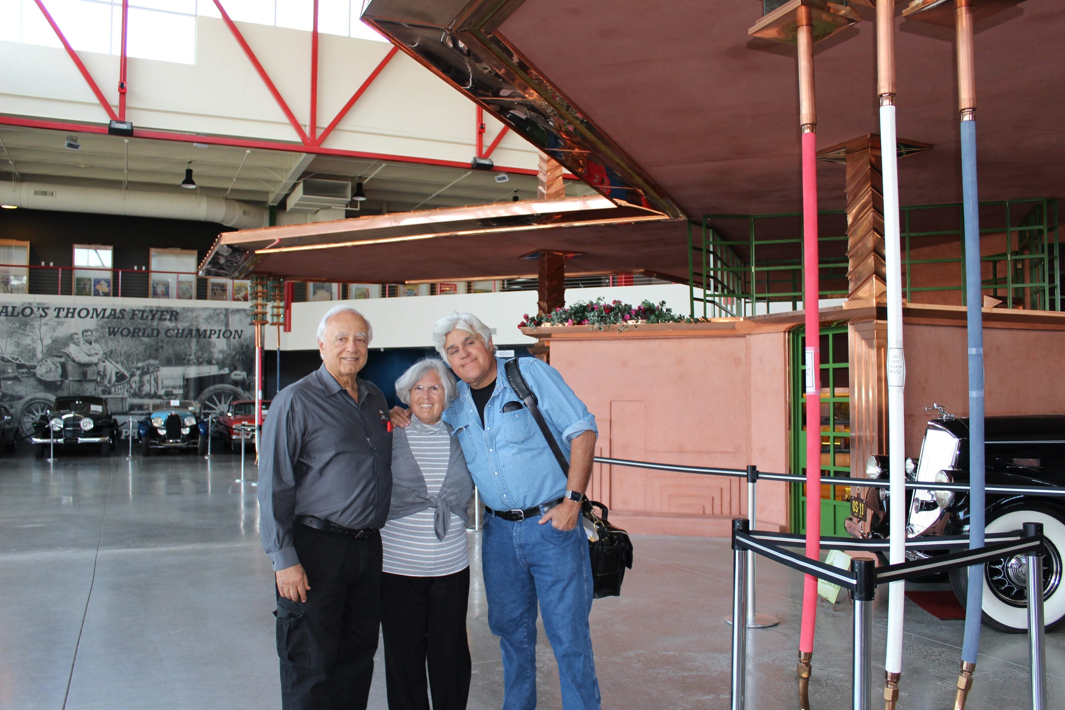 Jay Leno poses with owners James and Mary Ann Sandoro at the Buffalo Transportation/Pierce-Arrow Museum on Friday. Leno was scheduled to perform in the evening in Niagara Falls, Ont.