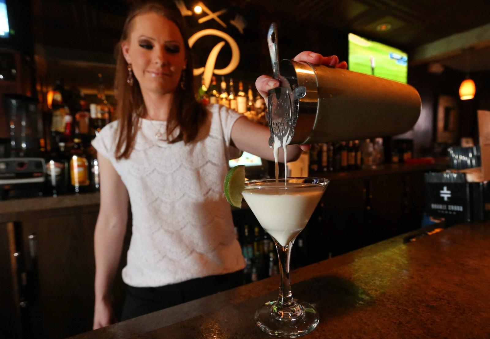 Bartender Jennifer Maulucci makes a key lime martini at Protocol Restaurant. (Sharon Cantillon/Buffalo News)