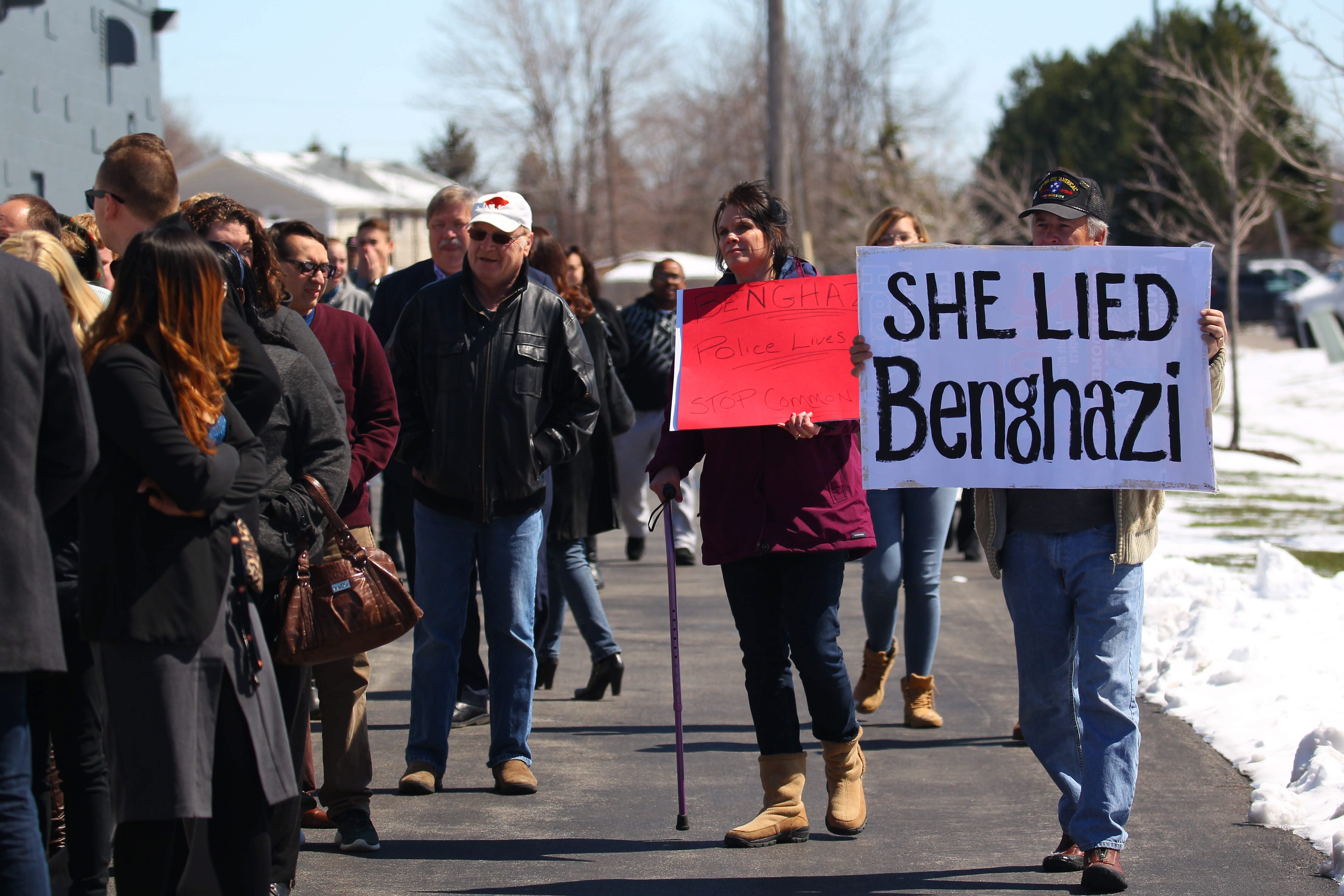 Protestors walk past Clinton supporters as they line up before former president Bill Clinton arrives for his appearance in Cheektowaga Tuesday, April 5, 2016.   (Mark Mulville/Buffalo News)