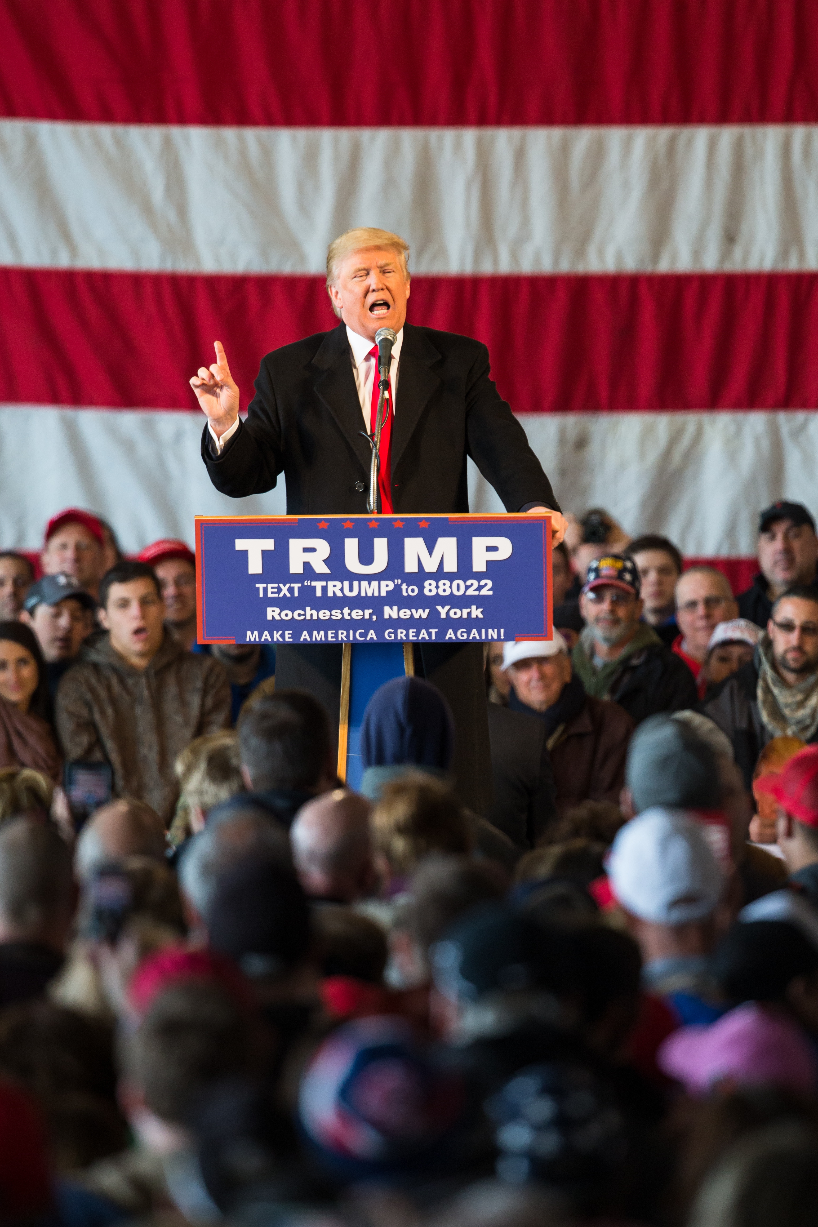 Republican presidential candidate Donald Trump speaks in front of a capacity crowd at a rally for his campaign Sunday in Rochester.
