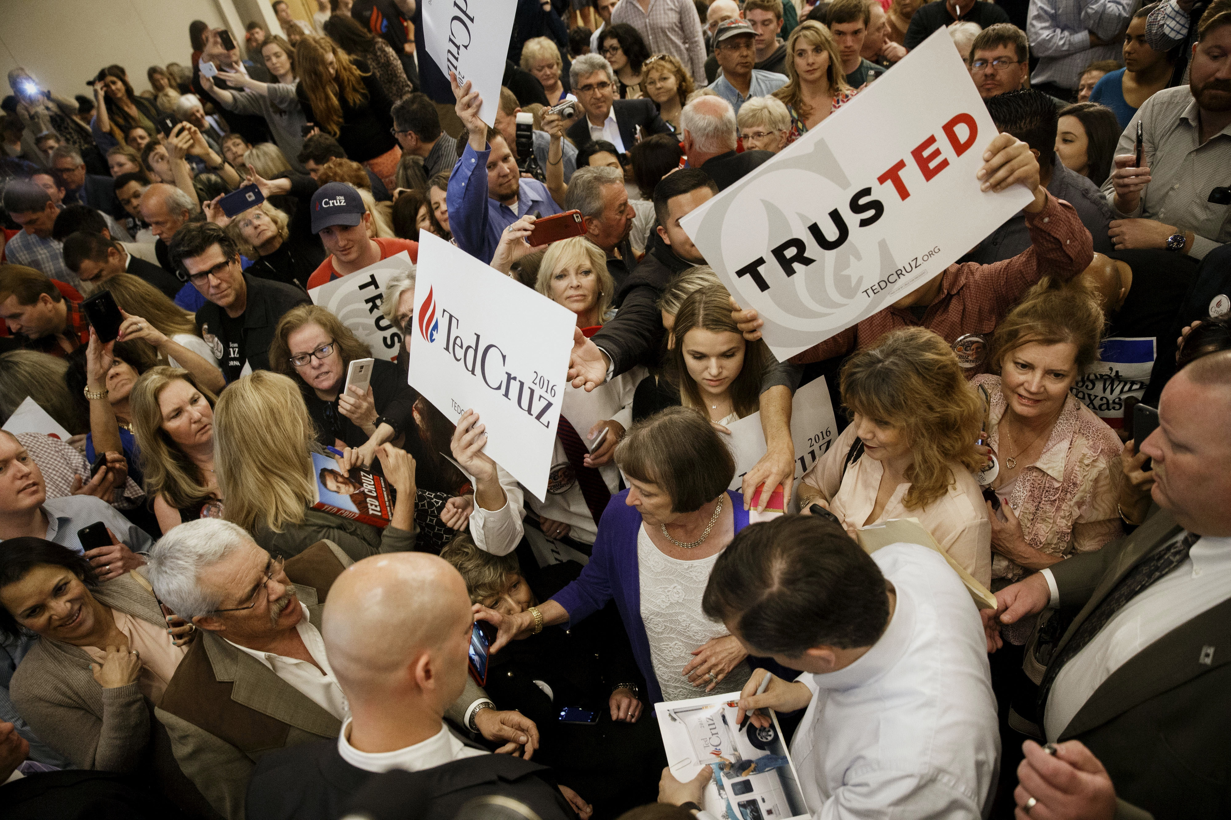 Republican presidential candidate Ted Cruz autographs items for his supporters at a campaign event in Irvine, Calif., on Monday. The Texas senator will be pushing for votes Thursday and Friday in Amherst, New York City, Binghamton, Syracuse and Rochester.