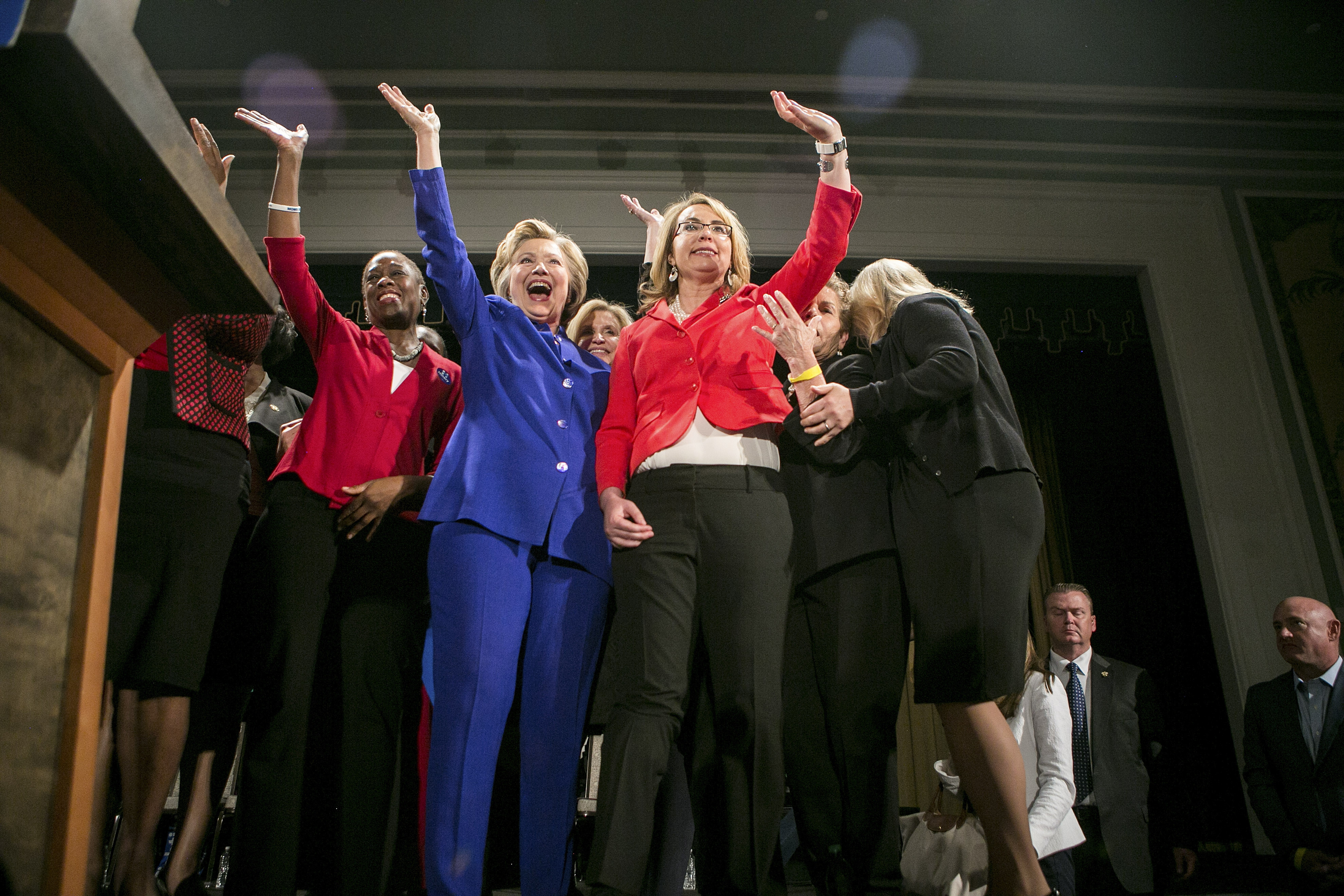 Rep. Gabrielle Giffords, right, came to support Hillary Clinton at an emotional rally that focused in part on gun laws Monday at the Hilton Hotel banquet hall in midtown Manhattan.