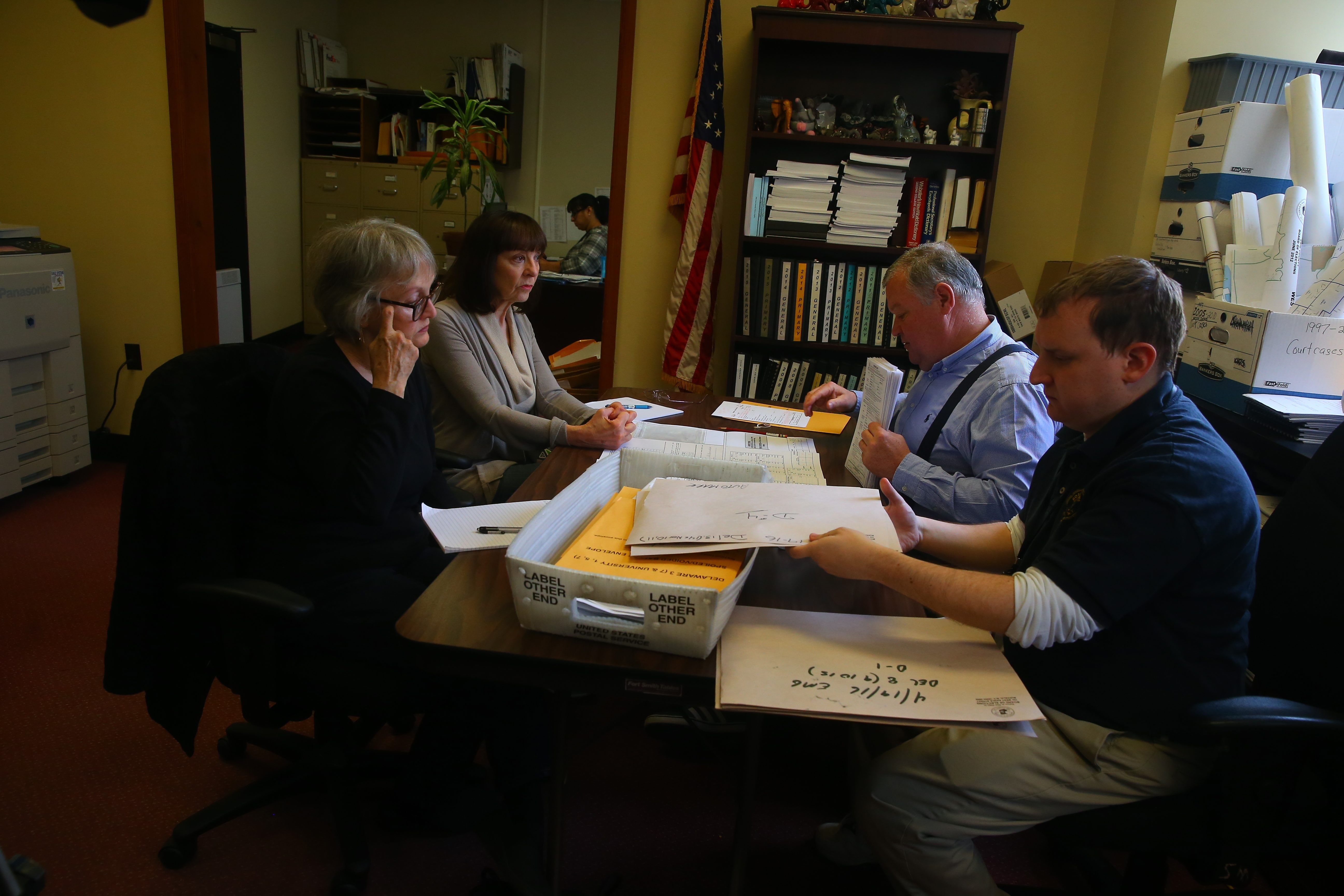 Bernie Sanders supporters, left, watch as Erie County Election Commissioner Ralph Mohr, top right, and clerk Matthew Jowsey tabulate affidavit ballots from primary.