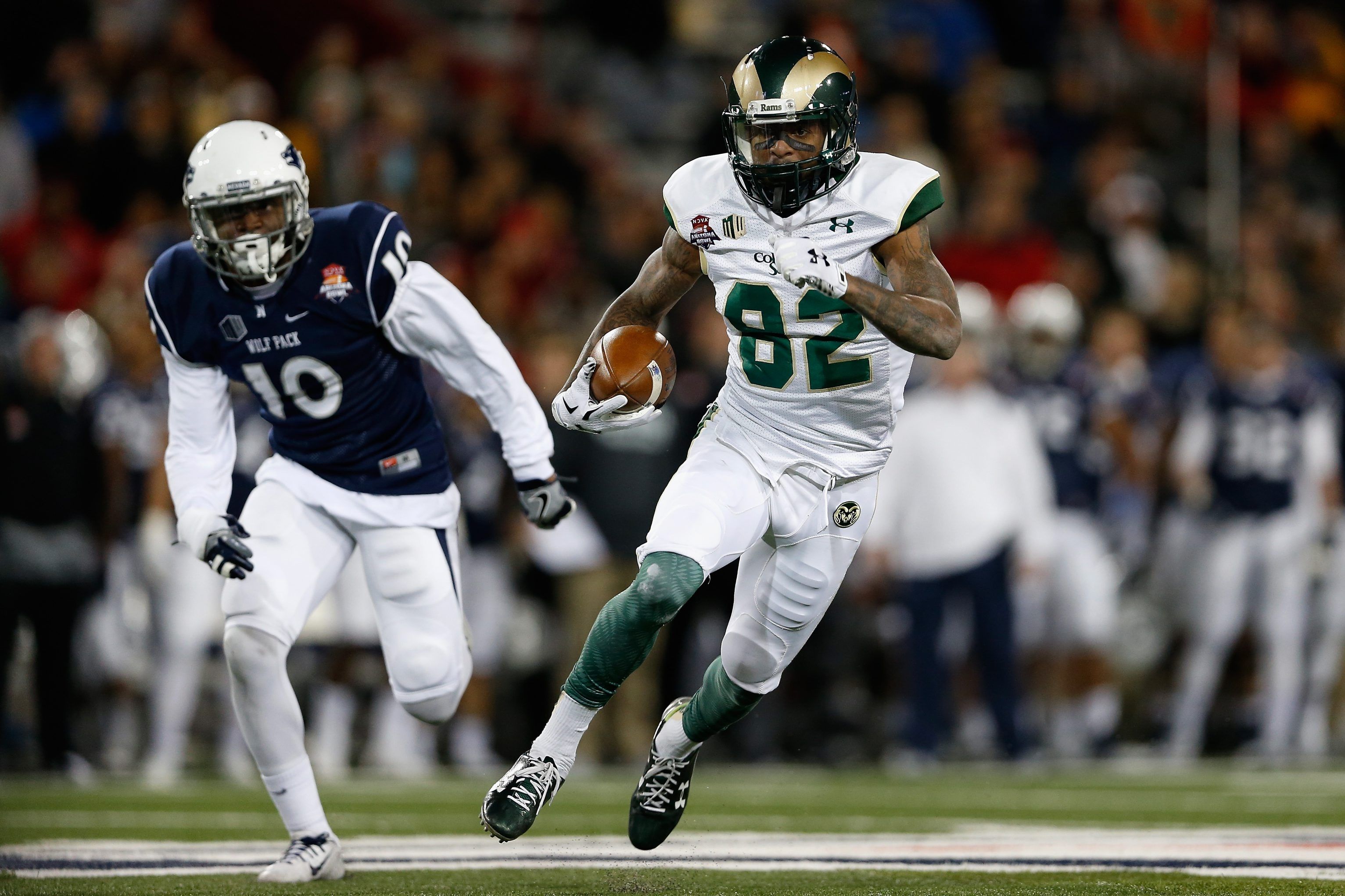 Colorado State Rams wide receiver Rashard Higgins runs with the football after a reception past Nevada Wolf Pack linebacker L.J. Jackson.
