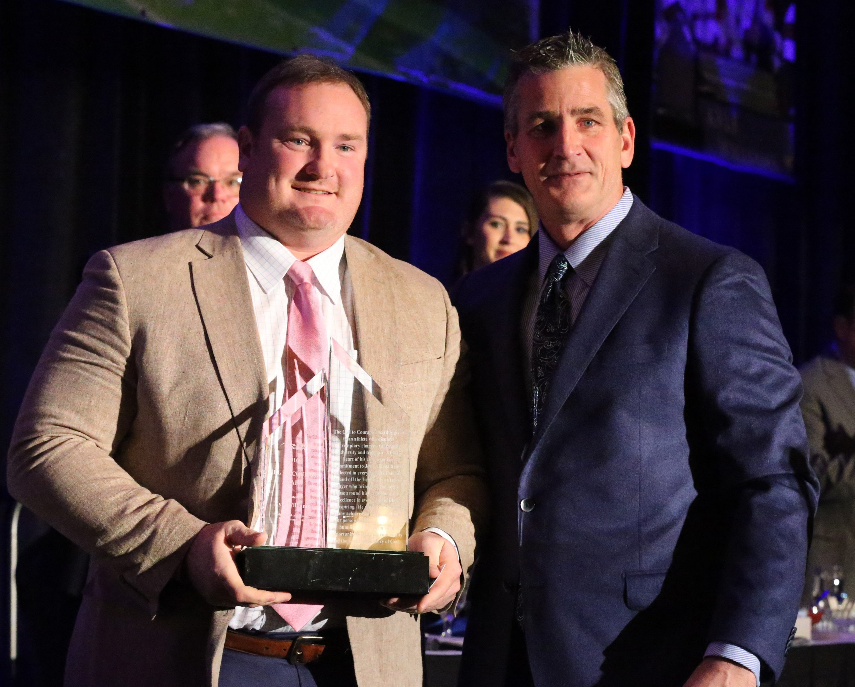 Frank Reich, right, presents the Call to Courage award to the Bills' Kyle Williams. The award honors a current NFL player who shows exemplary character, a commitment to Jesus Christ and community service.