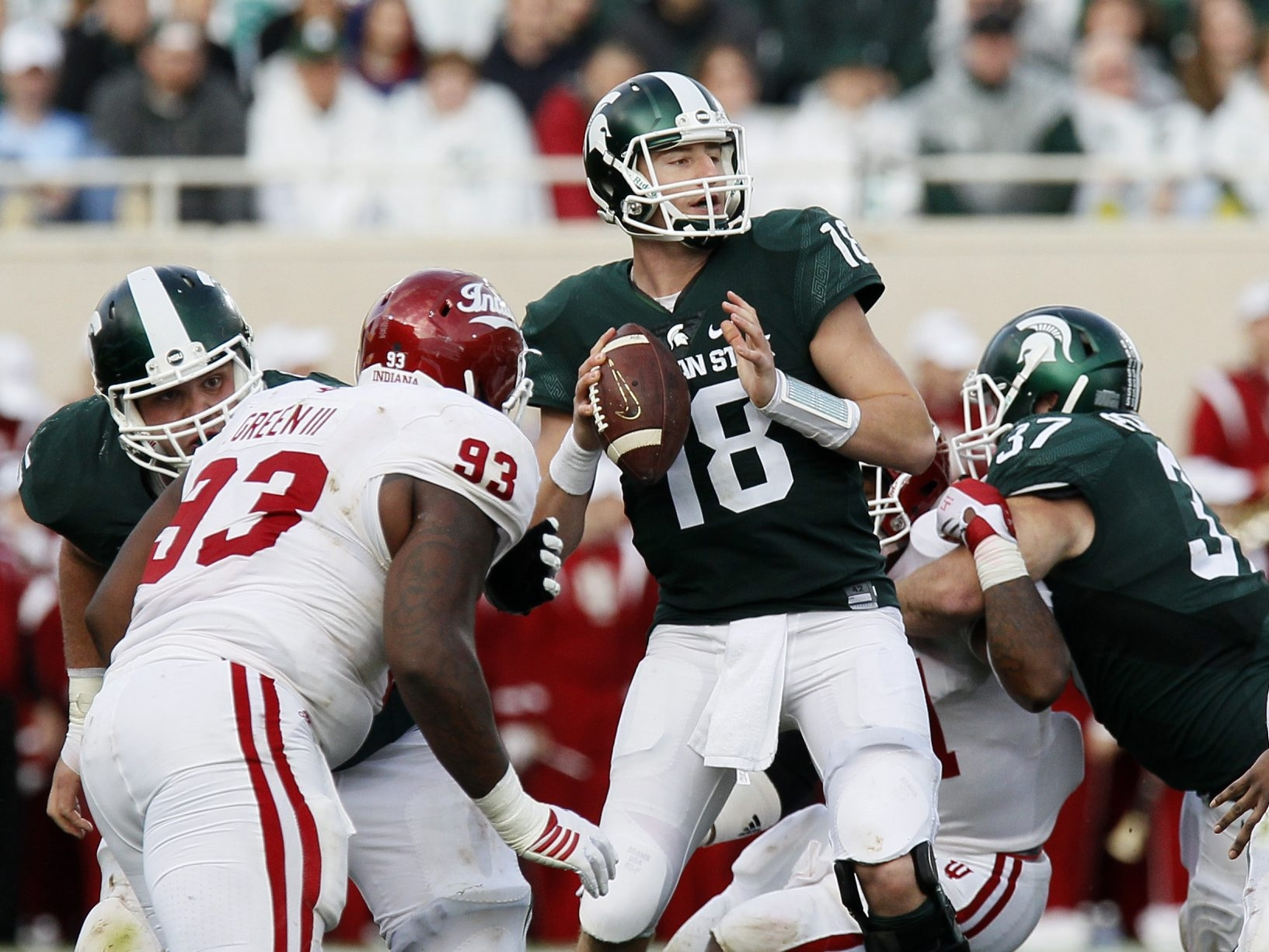 Michigan State Spartans quarterback Connor Cook (18) looks to pass the ball as Indiana Hoosiers defensive lineman Ralph Green III (93) closes in on Oct. 24 in East Lansing, Mich.