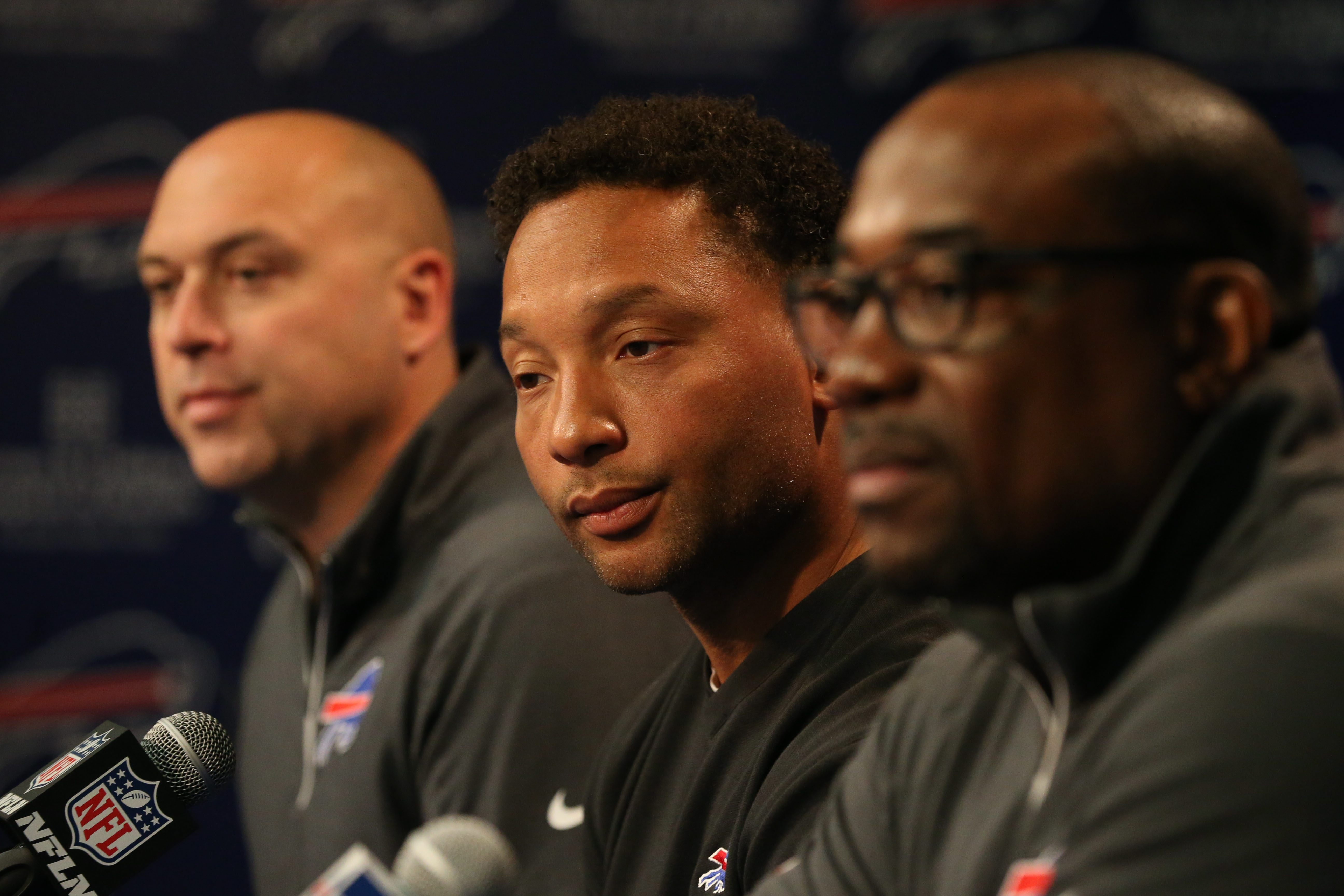 Bills GM Doug Whaley is flanked by player personnel director Jim Monos, left, and college scouting chief Kelvin Fisher on Wednesday.