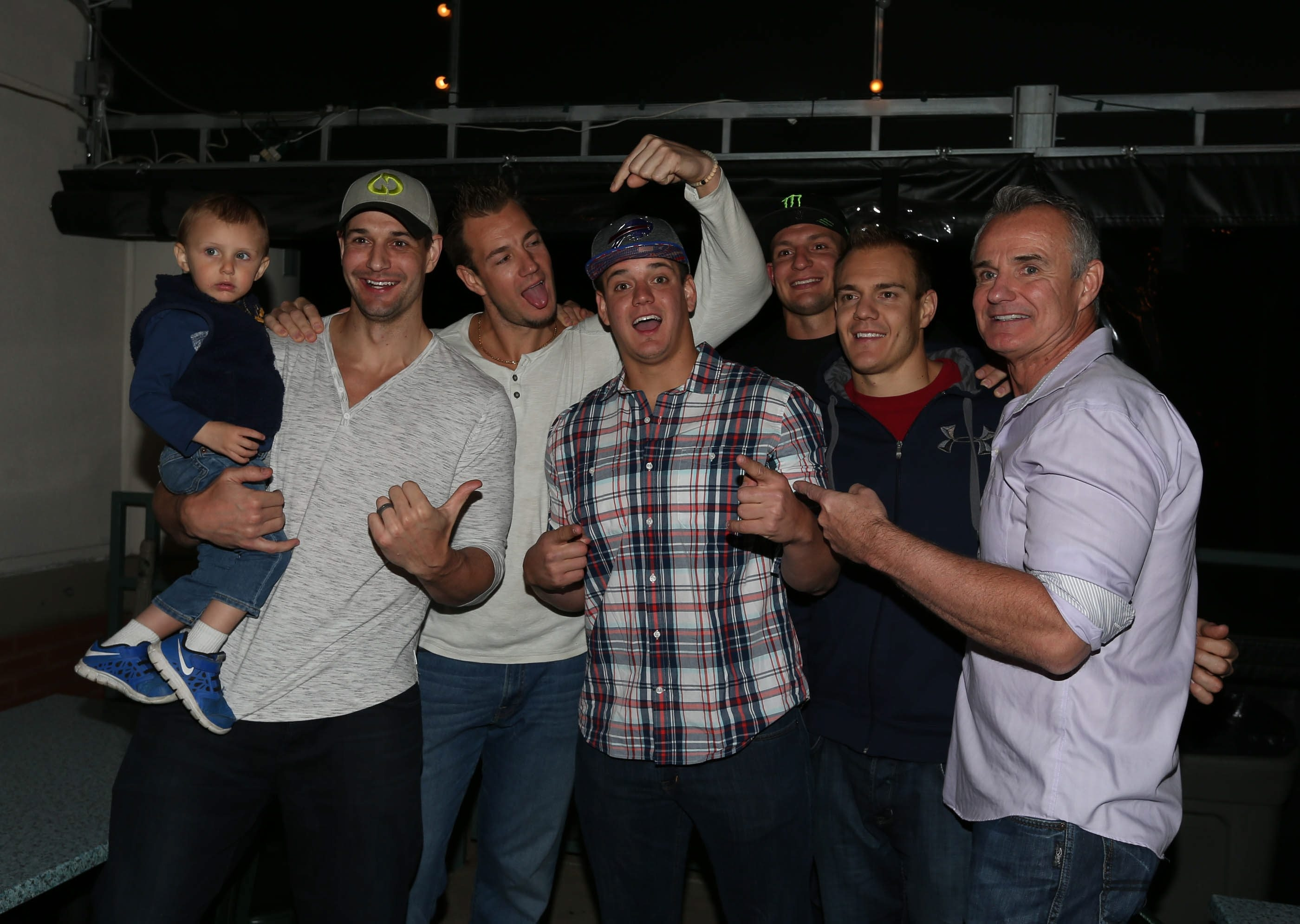 From left, Gordie Jr., Dan, Glenn, Rob, Chris, and Gordie Gronkowski celebrate Glenn's signing as a free agent with the Bills.