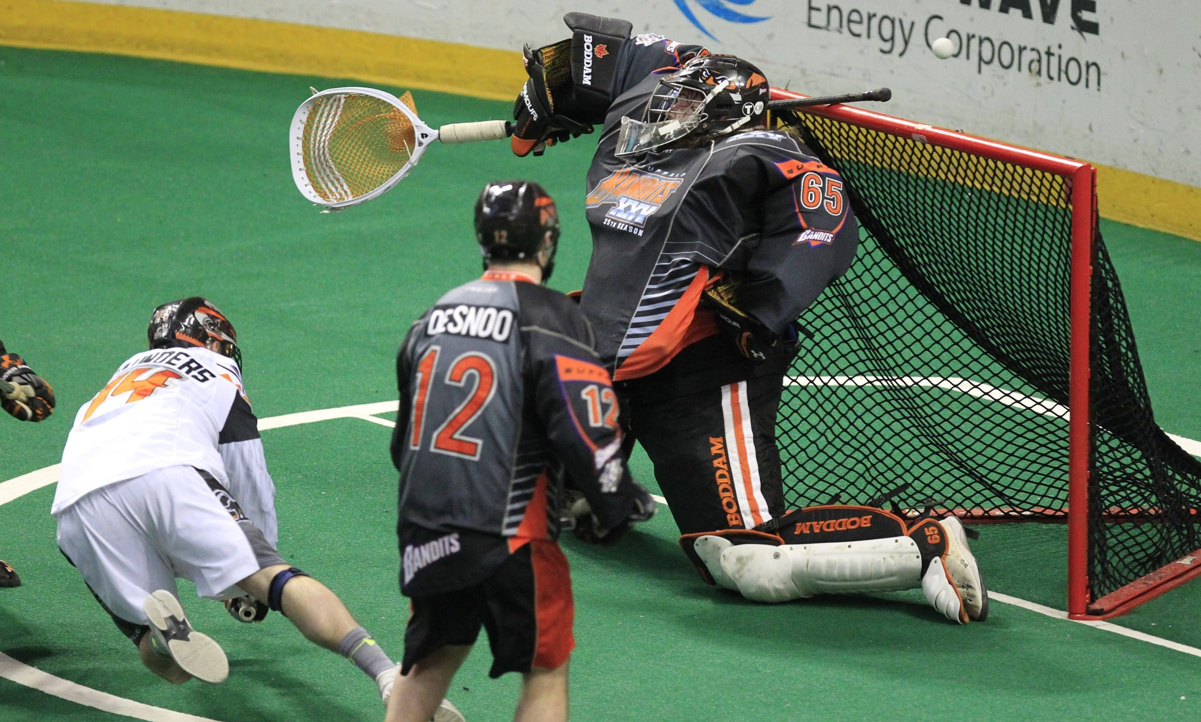Bandits goaltender Anthony Cosmo makes a save on Pat Saunders of New England during first half action at the First Niagara Center on Saturday.