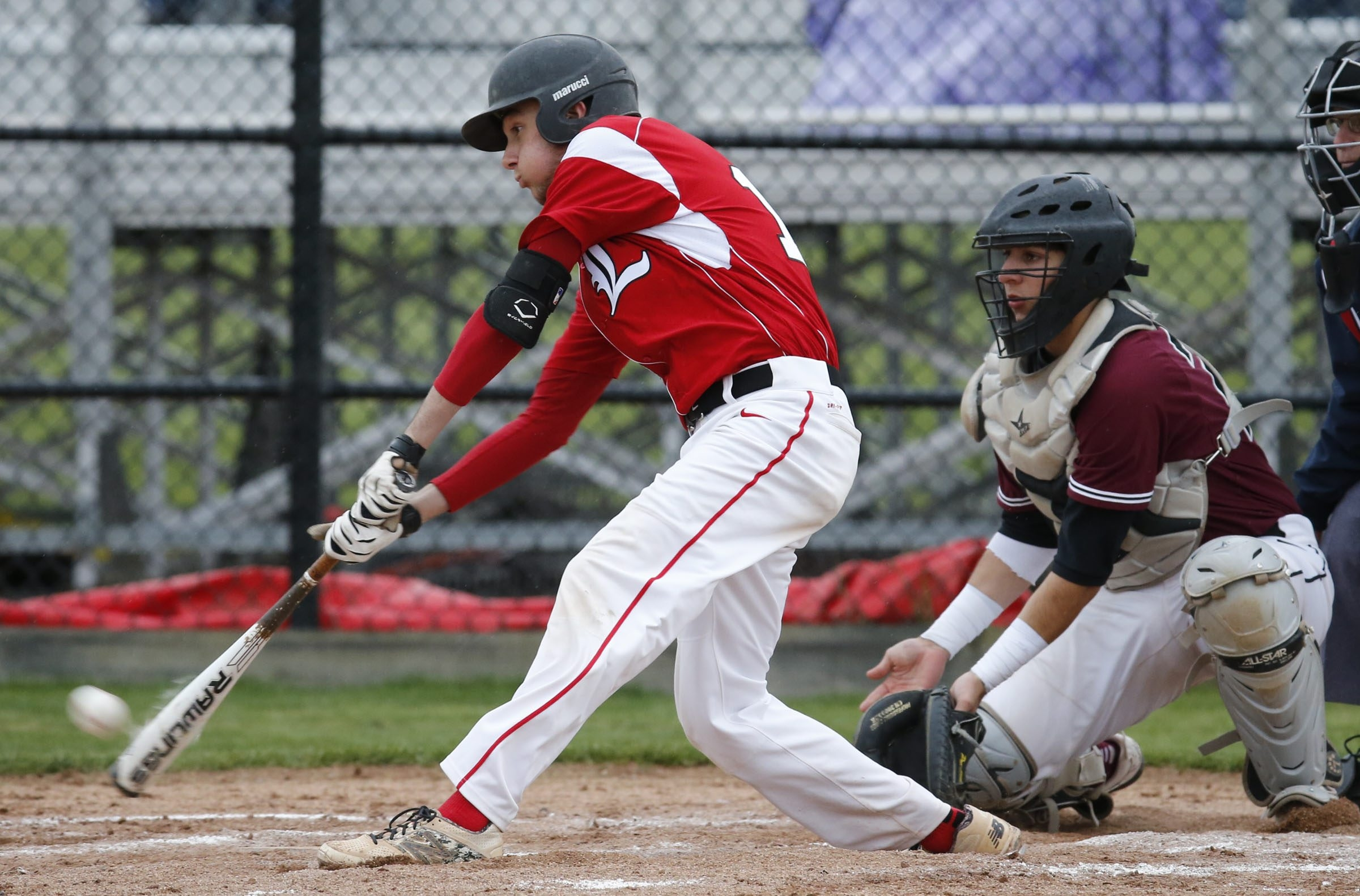 Lancaster's Max Giordano hits a RBI double during the first inning against Orchard Park. He also threw a one-hitter in an impressive victory.