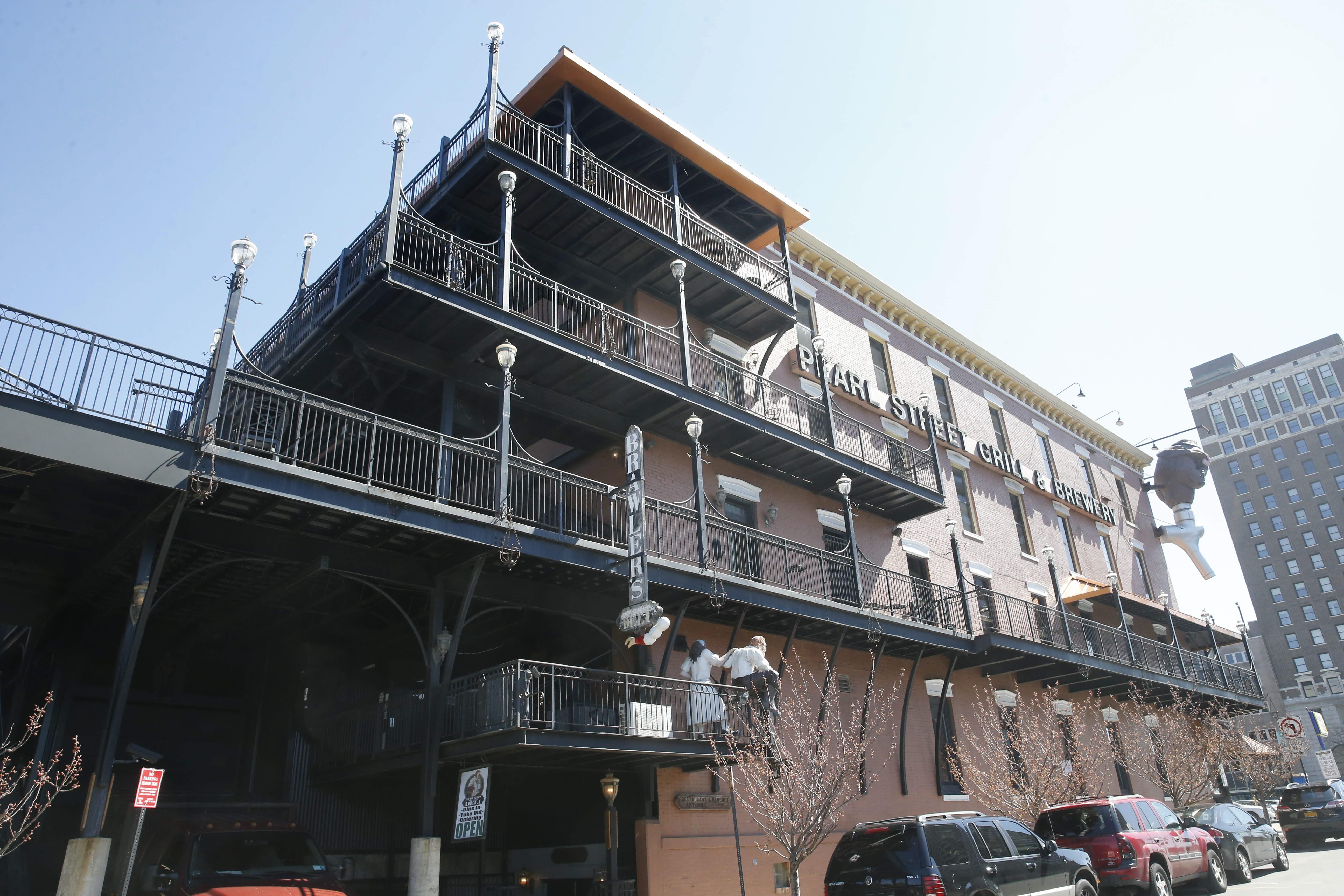 Thomas J. Krickovich was hanging by his hands from the railing on the balcony on the fourth floor of the Pearl Street Grill when he fell, hit the Brawlers sign below and then landed on the sidewalk.