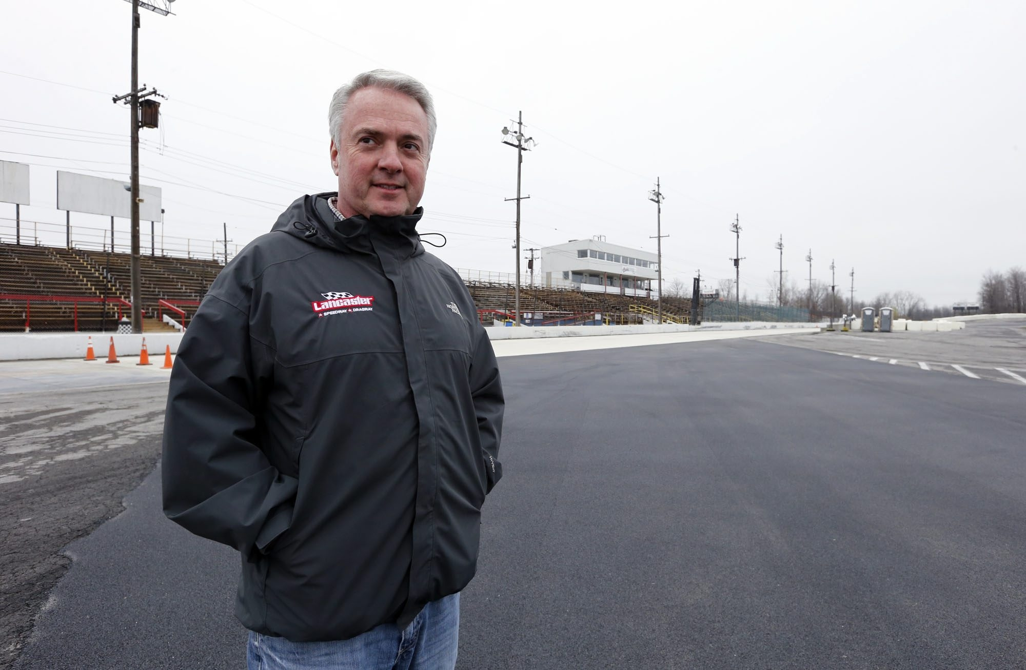 2 lien cut Tim Packman, Lancaster Track President looks over the new concrete and paving at Lancaster Speedway&Dragway on Tuesday, April 26, 2016. ()