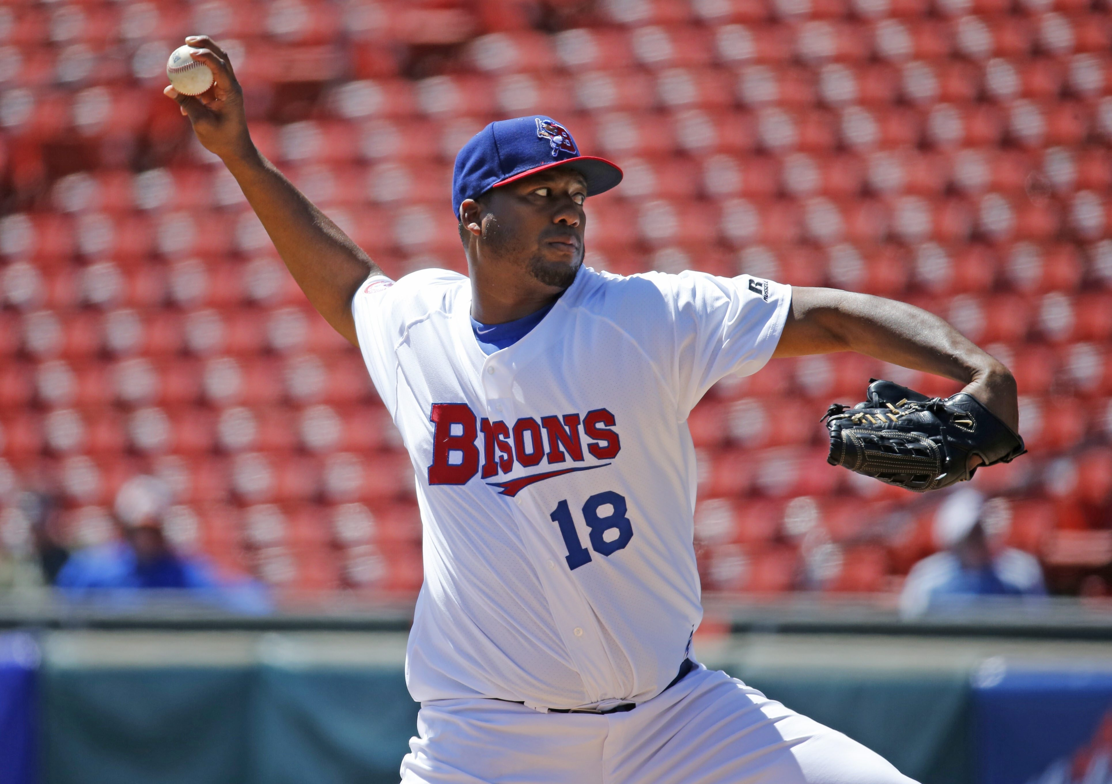 one lei ncut Buffalo Bisons pitcher Roberto Hernandez delivers a third inning pitch against the Rochester Red Wings at Coca-Cola Field on Wednesday, April 27, 2016. ()