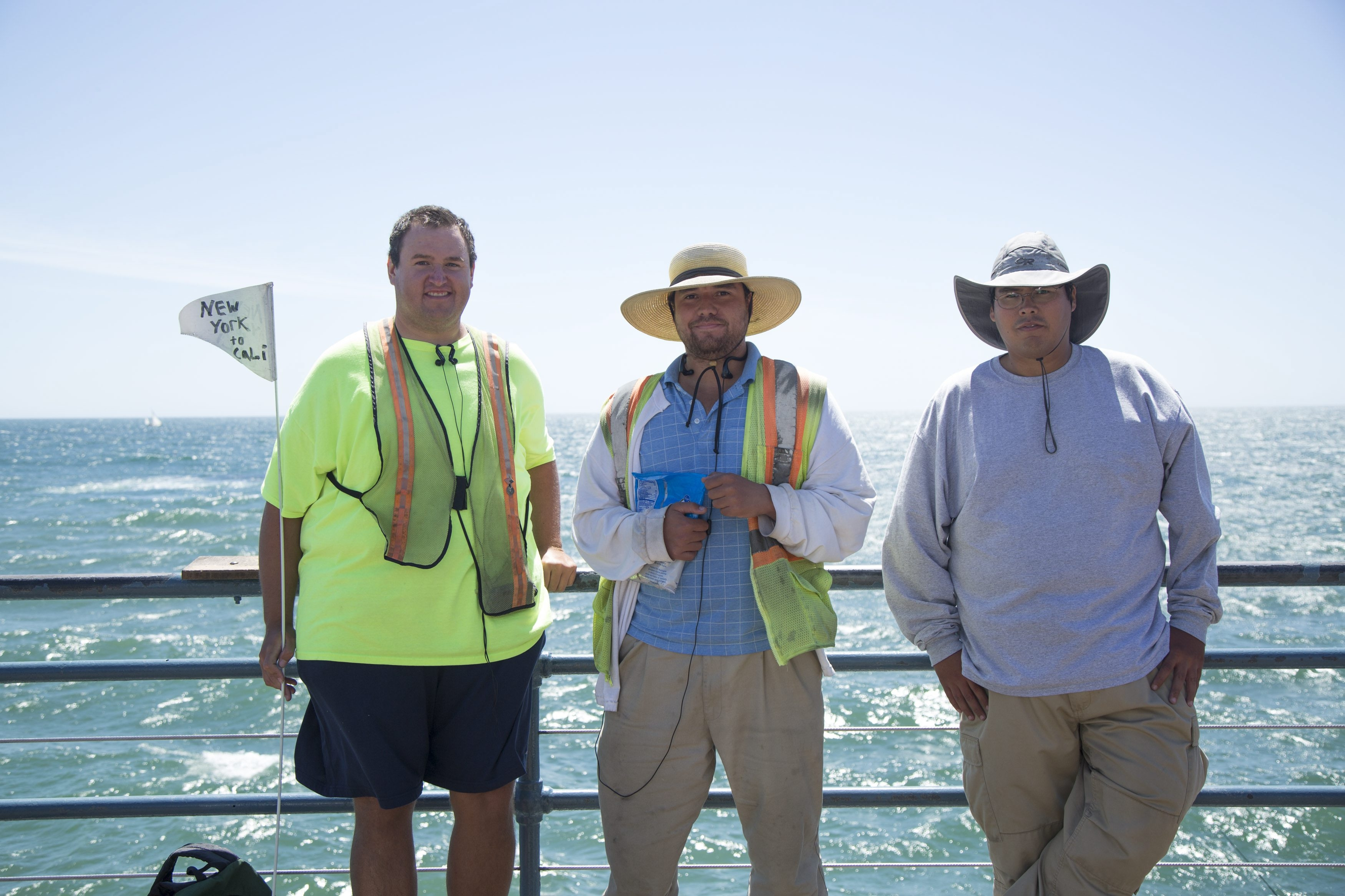 From left, Jason Rogers, Joe Cooke and Chris Cooke stand on the Santa Monica Pier overlooking the Pacific Ocean.