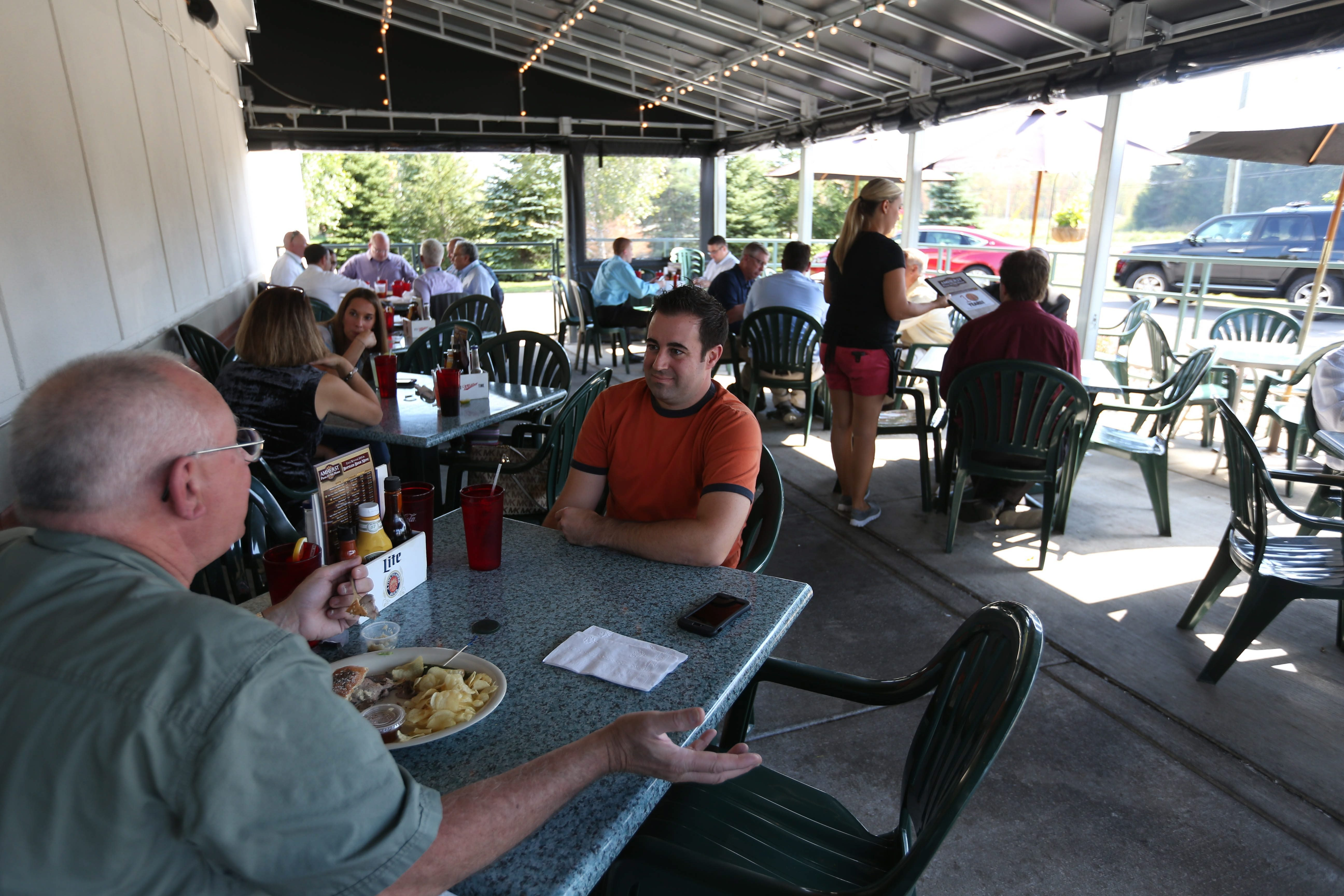 """Amherst Pizza & Ale House has a folder full of ideas for breakfast pizzas, but don't look for them on the menu. """"We don't open for brunch at all,"""" said owner John Bona III, """"and the main reason for that is most people want to enjoy a mimosa or a bloody mary with their brunch."""" (Sharon Cantillon/News file photo)"""