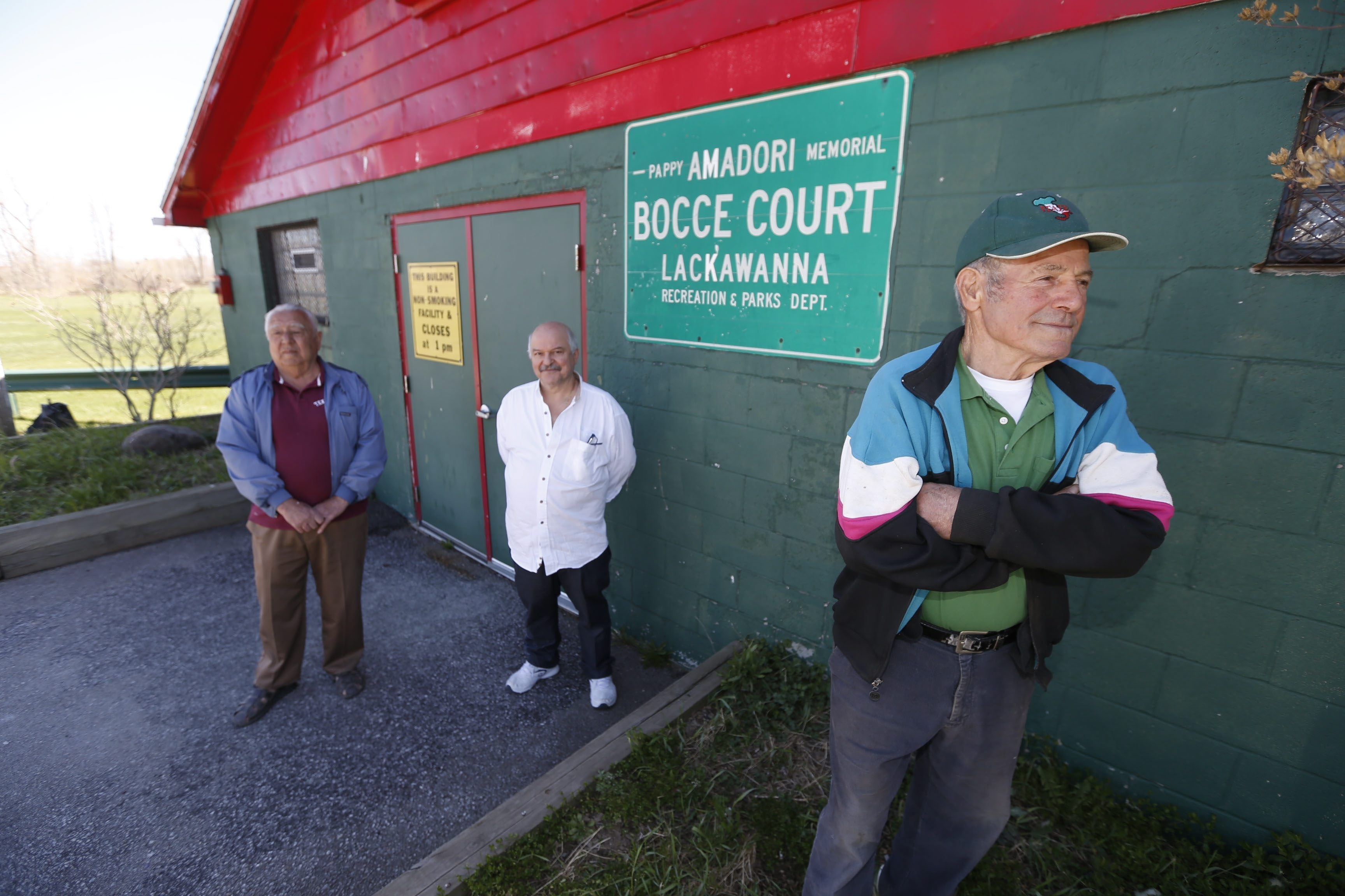 From left, Luigi Colafranceschi, Tom Collana and Remo Fischione stamd outside the now-closed Pappy Amadori Bocce Court on Madison Avenue in Lackawanna.