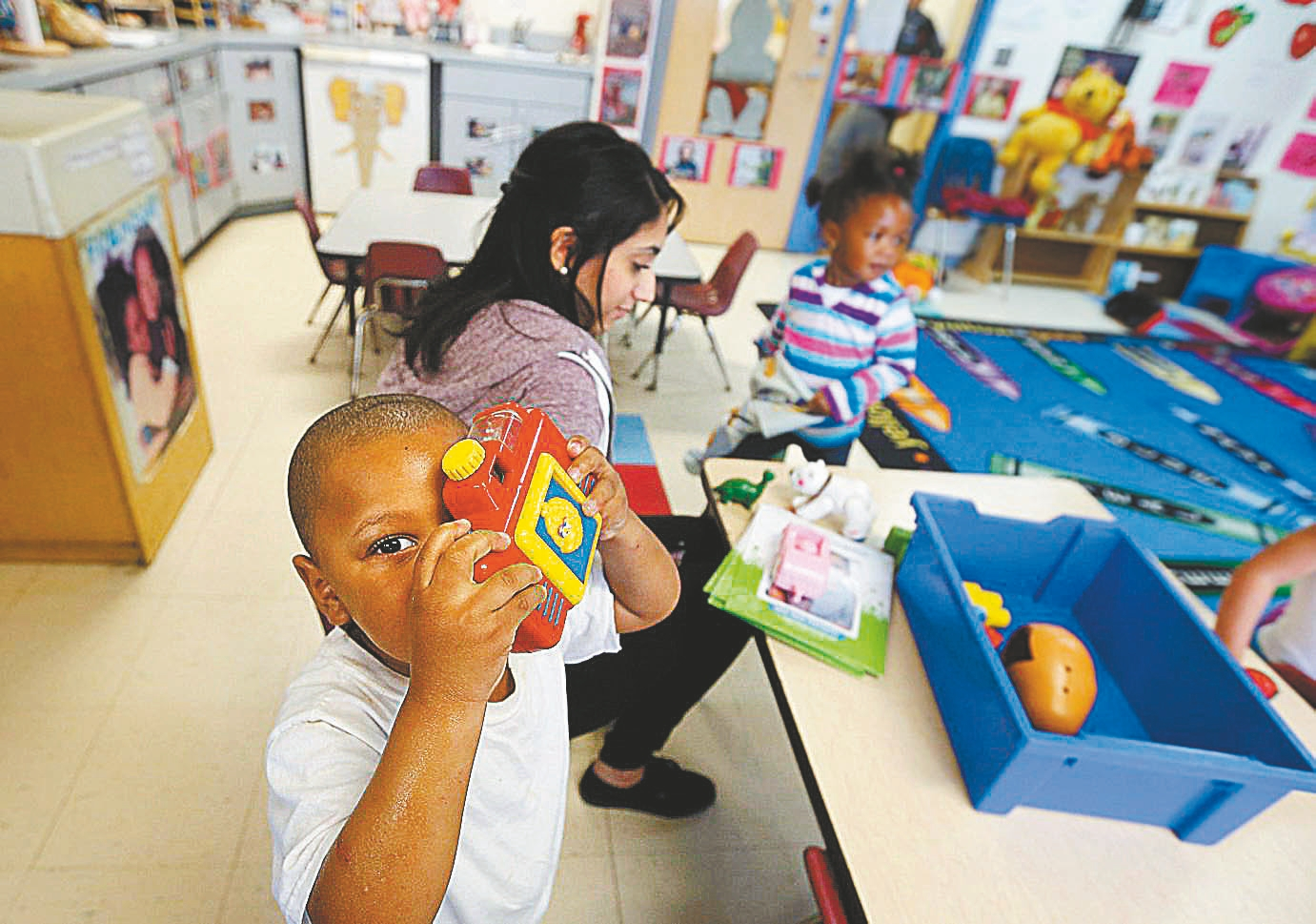 Children play in a classroom at Baden Street Settlement House, one of the agencies fighting poverty in Rochester. (Mark Mulville/Buffalo News)