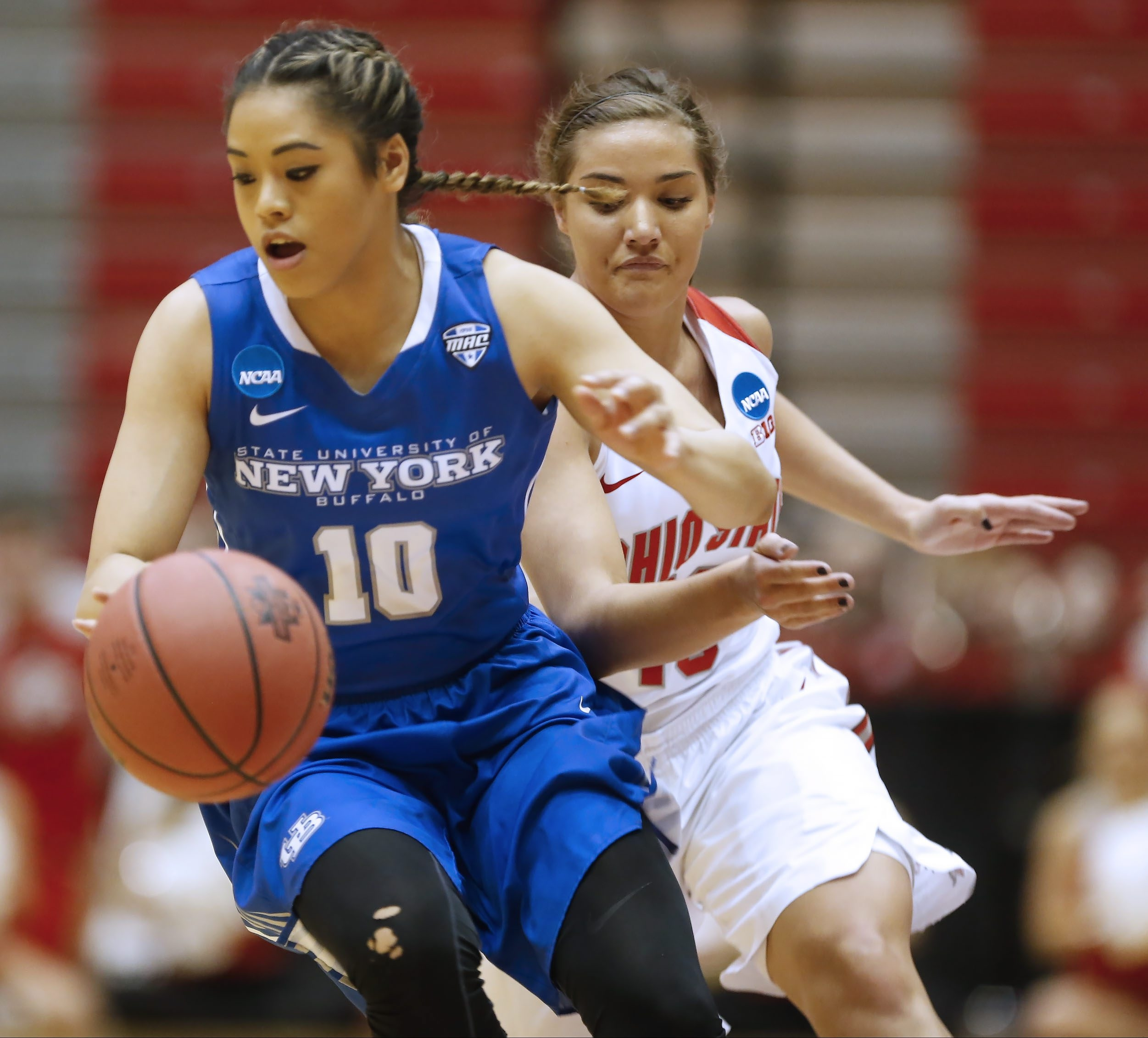 "The University at Buffalo's Gabi Bade is shown wearing a uniform in which ""New York"" is dominant over ""Buffalo."""
