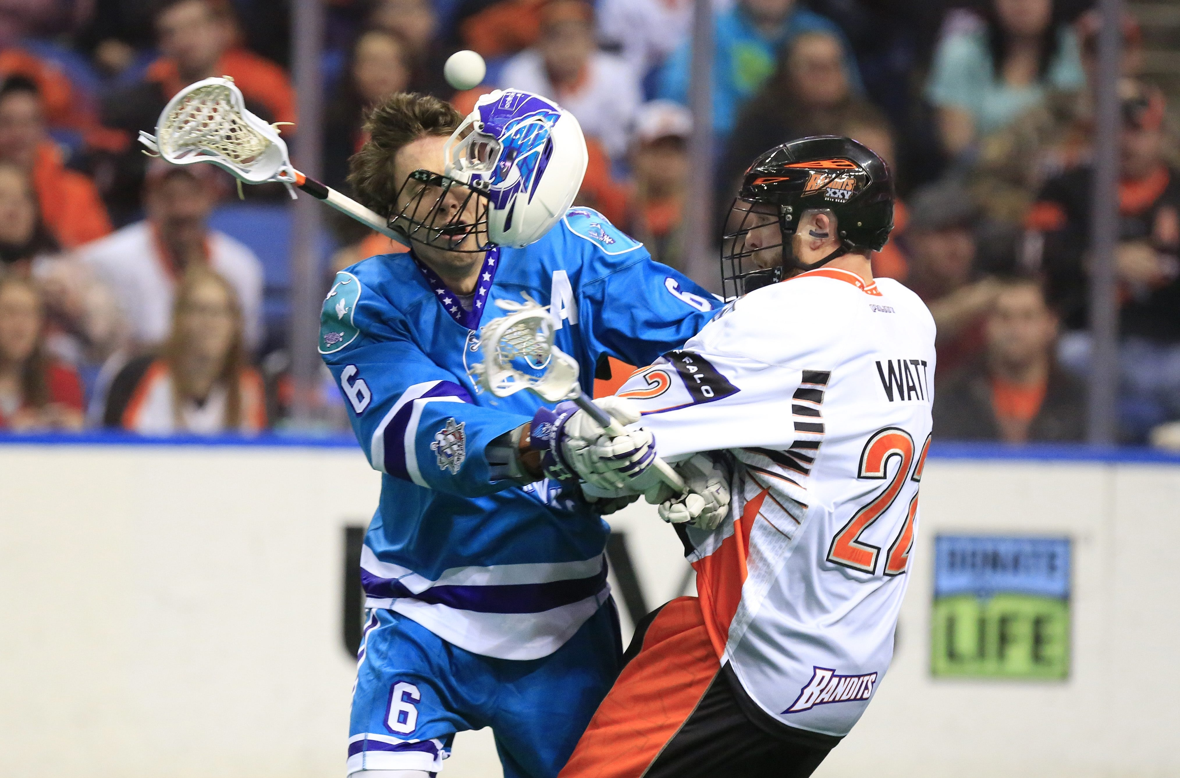 Buffalo's Andrew Watt knocks off the helmet of Rochester's Dan Dawson during the Bandits' 14-12 win Saturday.