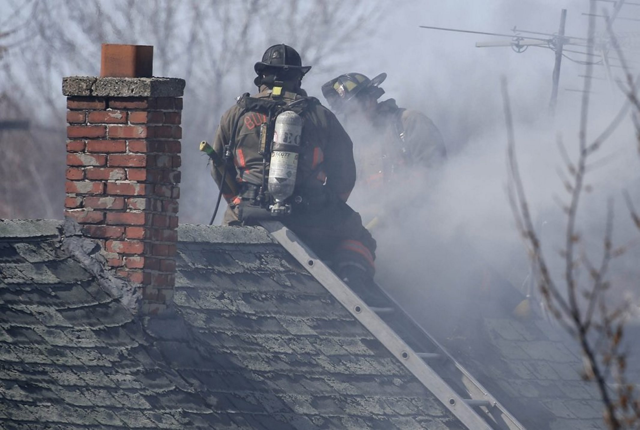 Buffalo firefighters battle a house fire on Newton Street on Saturday. Two firefighters were hurt in the blaze, but the residents of the house escaped injury.