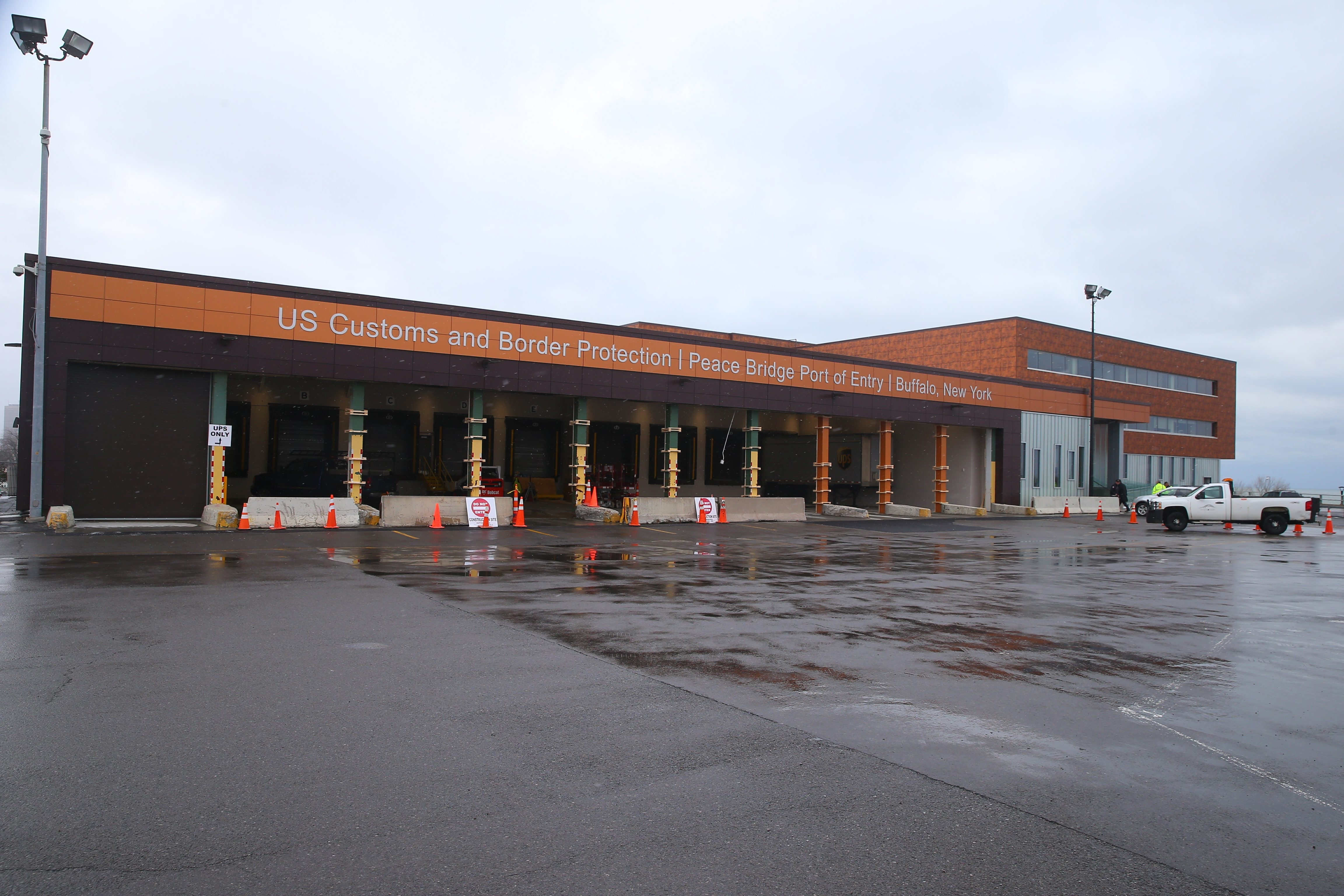 The $24 million renovation and expansion project at the U.S. Customs facility in Buffalo included the addition of truck inspection bays, top, and new conference rooms and work stations for Customs officials, above left and right.