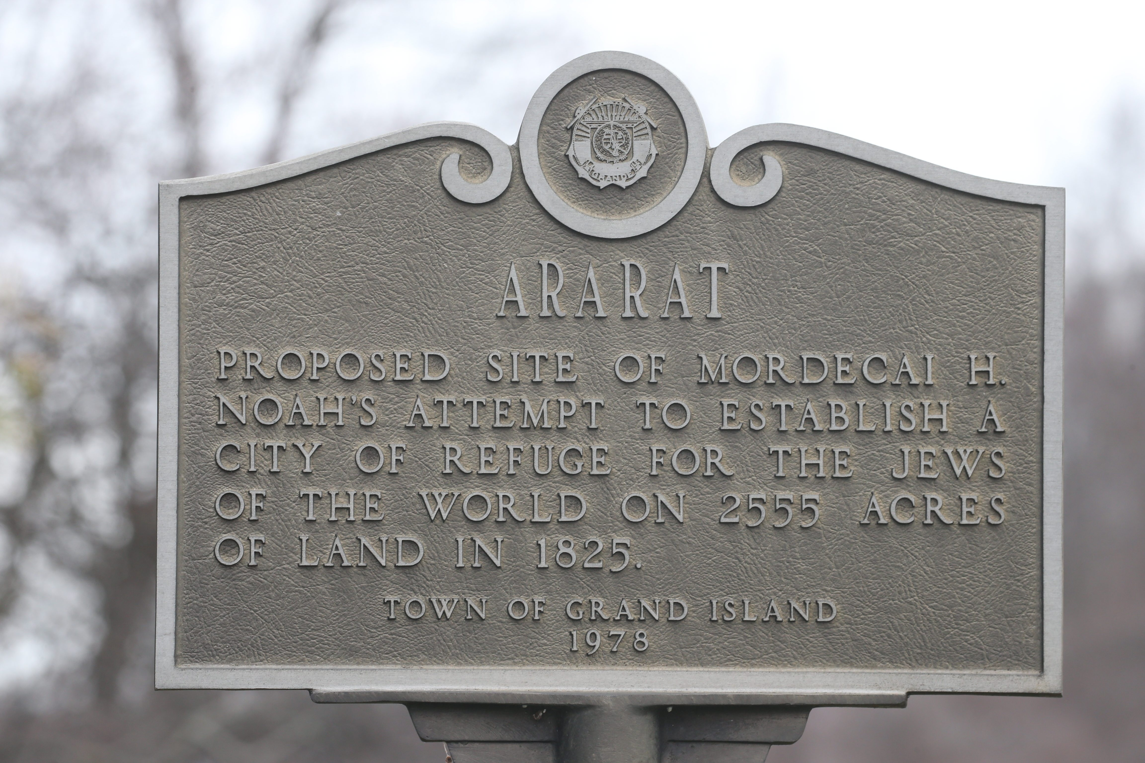 """A plaque honoring the attempt to create a Jewish homeland, called """"Ararat"""" on Grand Island."""
