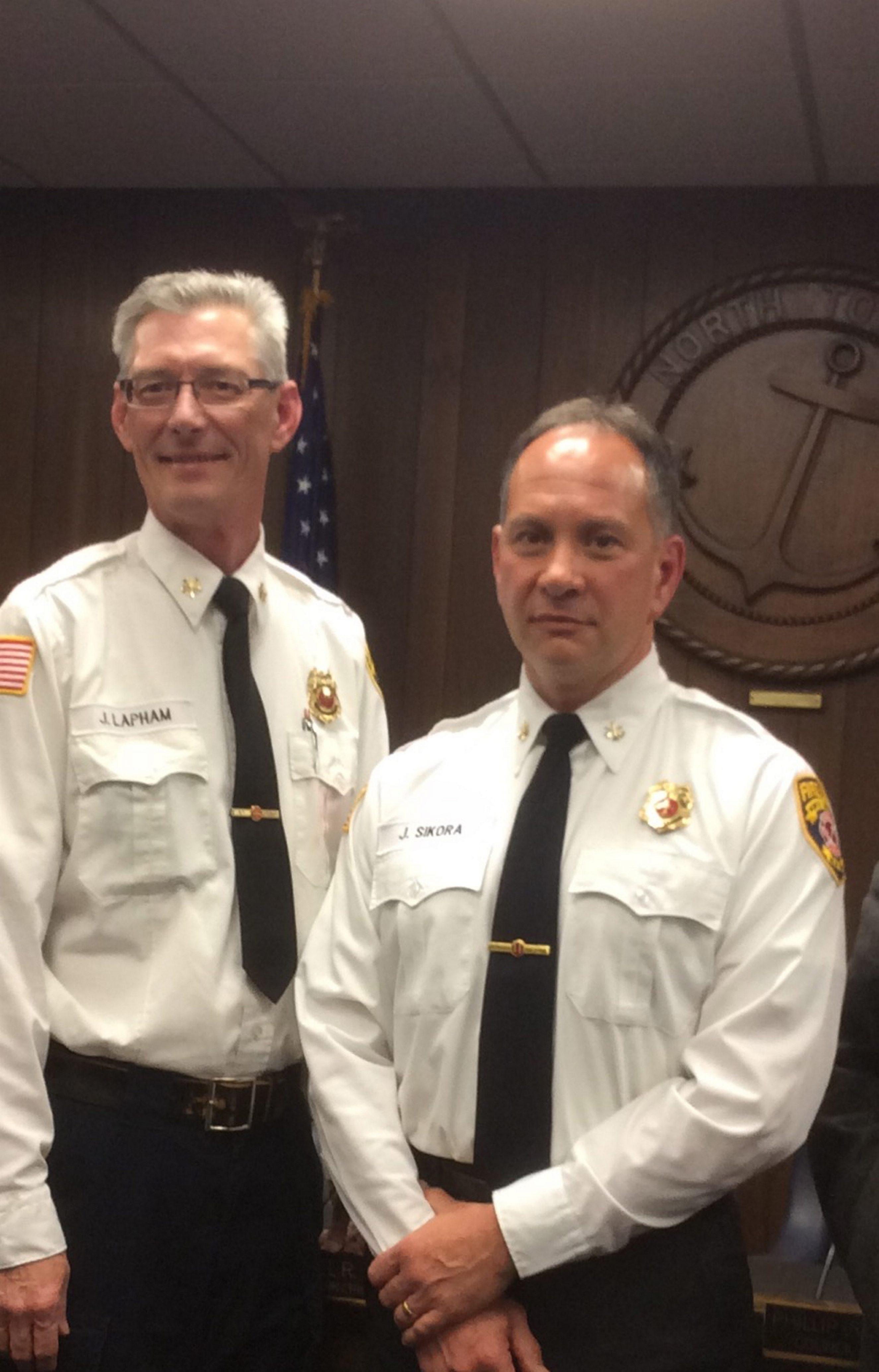 Joseph Sikora, right, was named North Tonawanda Fire Chief, taking over for Chief John C. Lapham who will retire on Thursday.