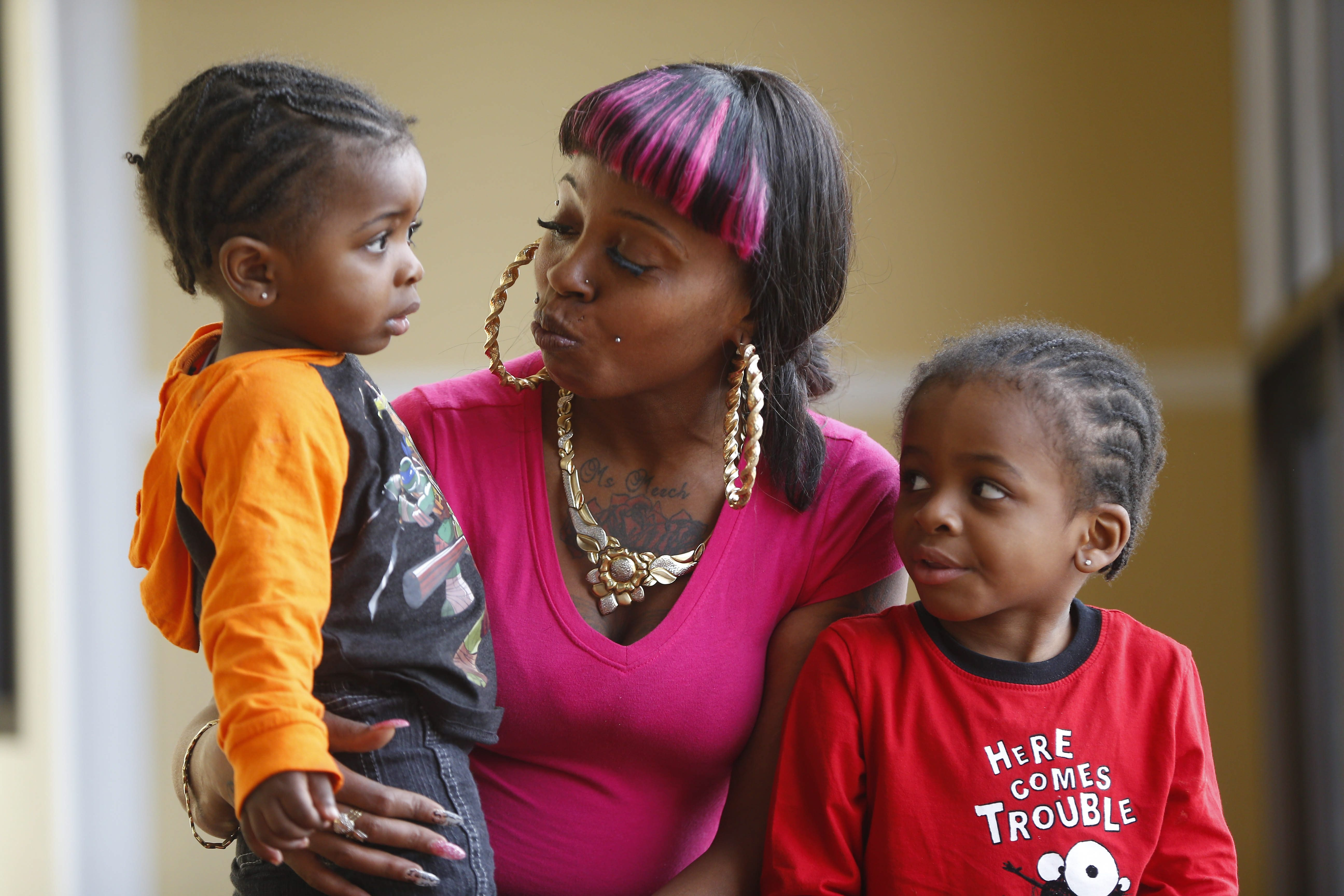 Tempest Thomas plays with her sons, DeMeriuse, 1, left, and DeMetrius Jr., 3, in Buffalo last month.