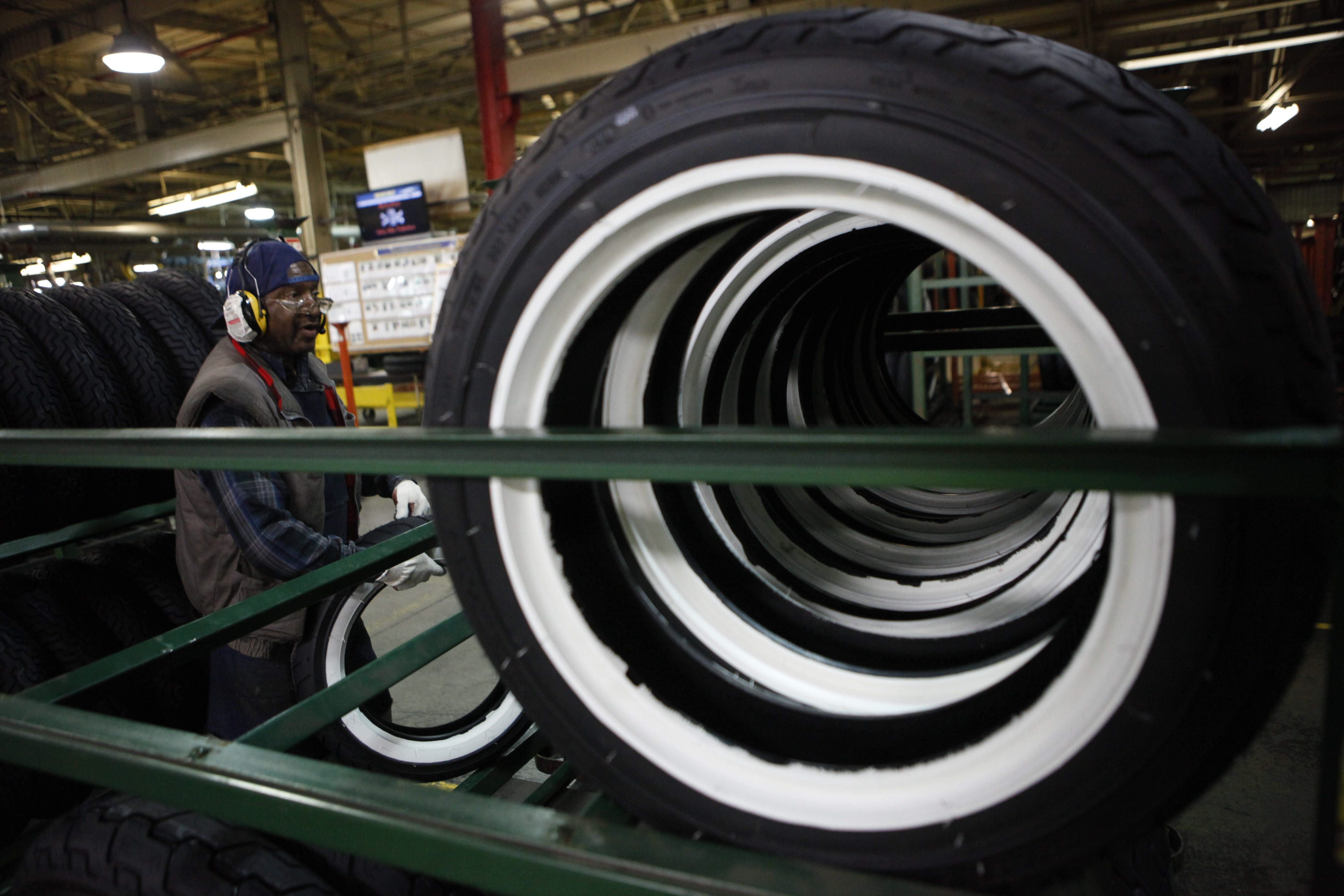A worker in the finishing area of the motorcycle tire business center at the former Goodyear Dunlop Tires North America production plant in the Town of Tonawanda. The company's new name is Sumitomo Rubber USA.  {News file photo)