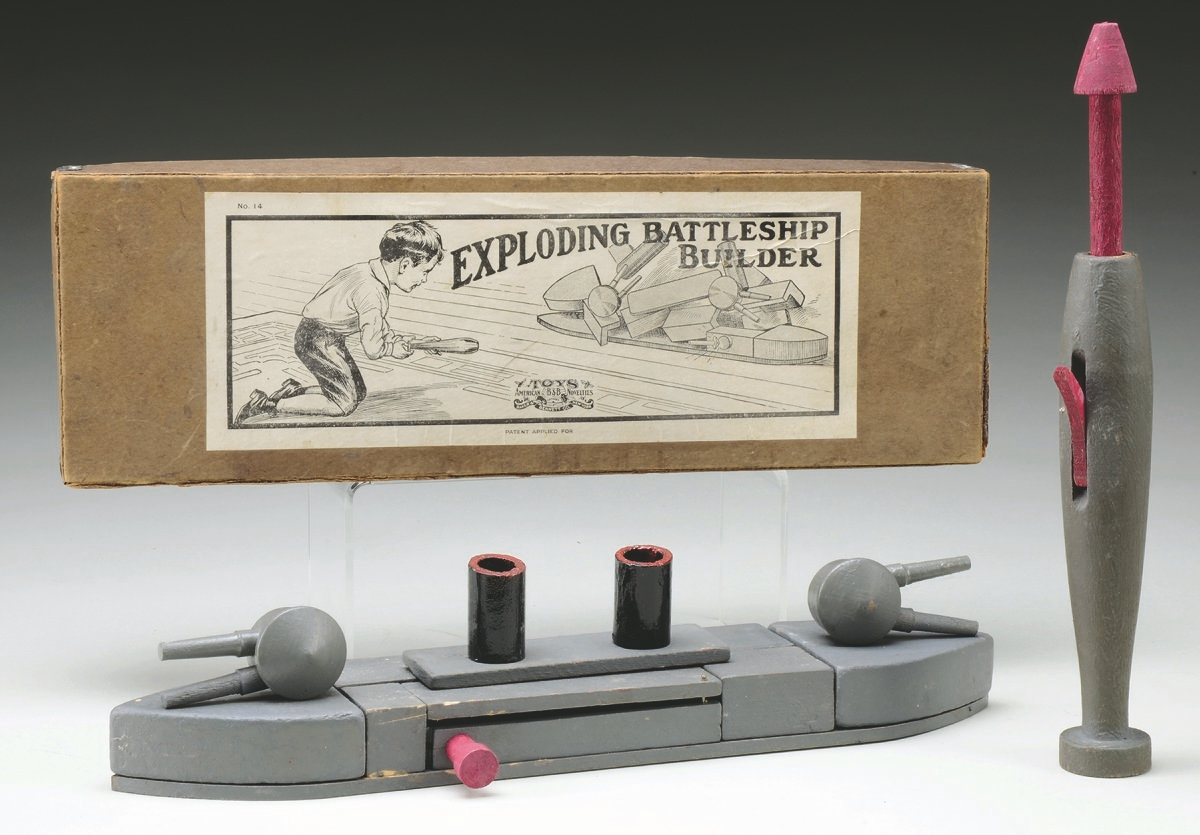 """The Exploding Battleship Builder really did blow up. It is made of wooden blocks and was """"destroyed"""" by a wooden cannon ball. A full boxed and labeled set auctioned for $237 in December 2015."""
