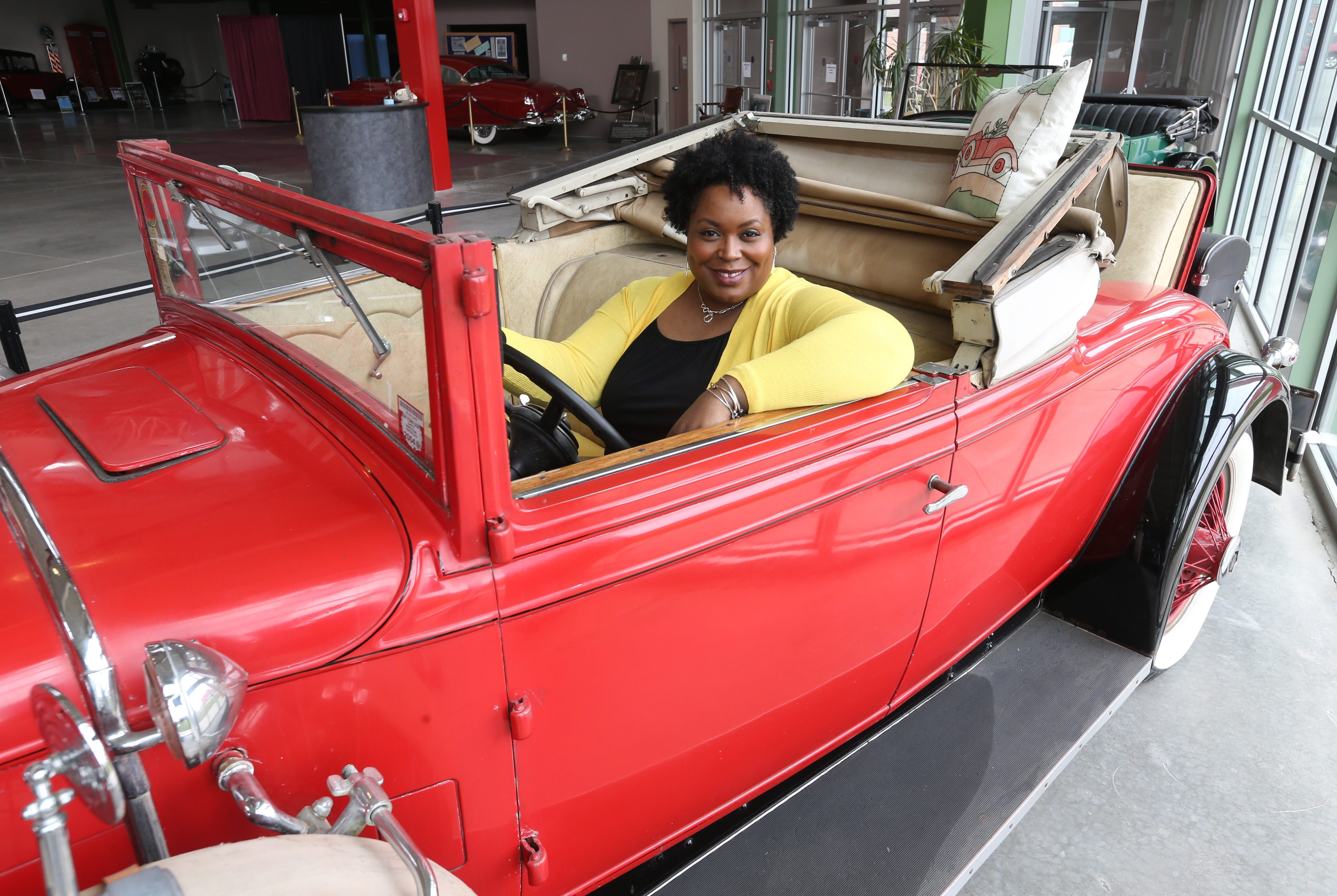 """""""I live in the front seat. I'm conscious about the decisions I make."""" – Kelly Marie Showard, founder of the Front Seat Chronicles, a social media campaign to share experiences and instill hope, in the front seat of a 1929 Stutz convertible at the Buffalo Transportation Pierce-Arrow Museum."""