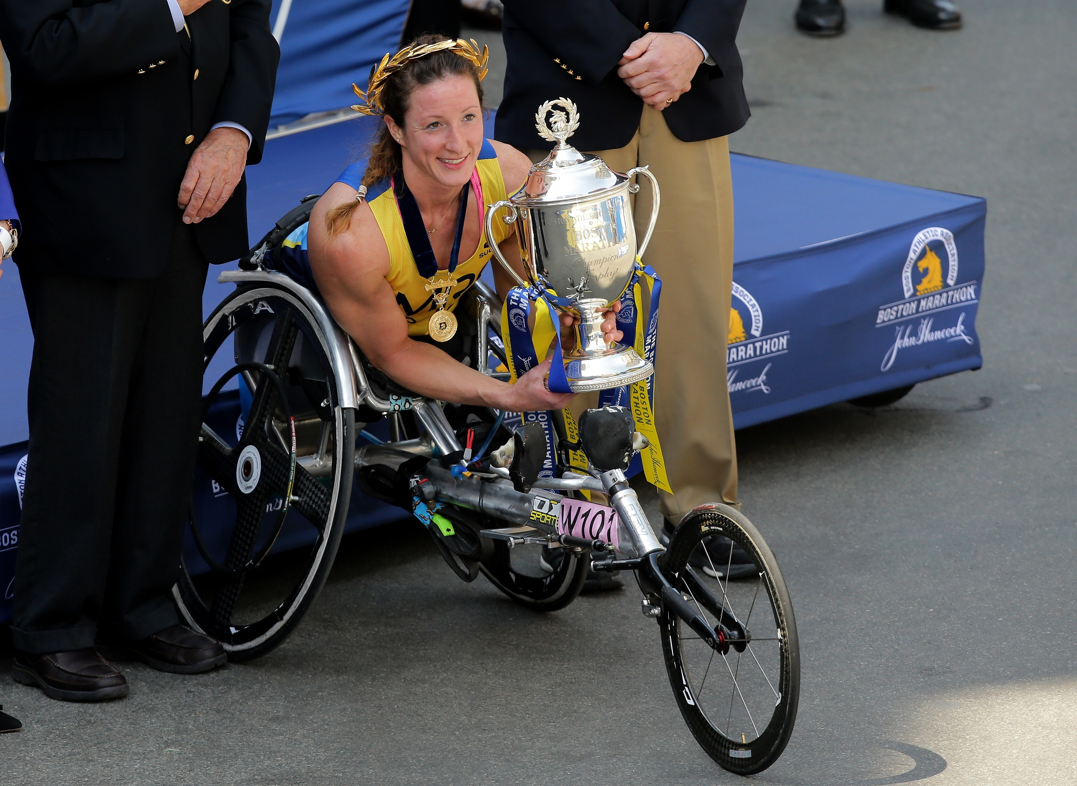 Tatyana McFadden of the United States poses after crossing the finish line to win the women's push rim wheelchair race during the 120th Boston Marathon on Monday.