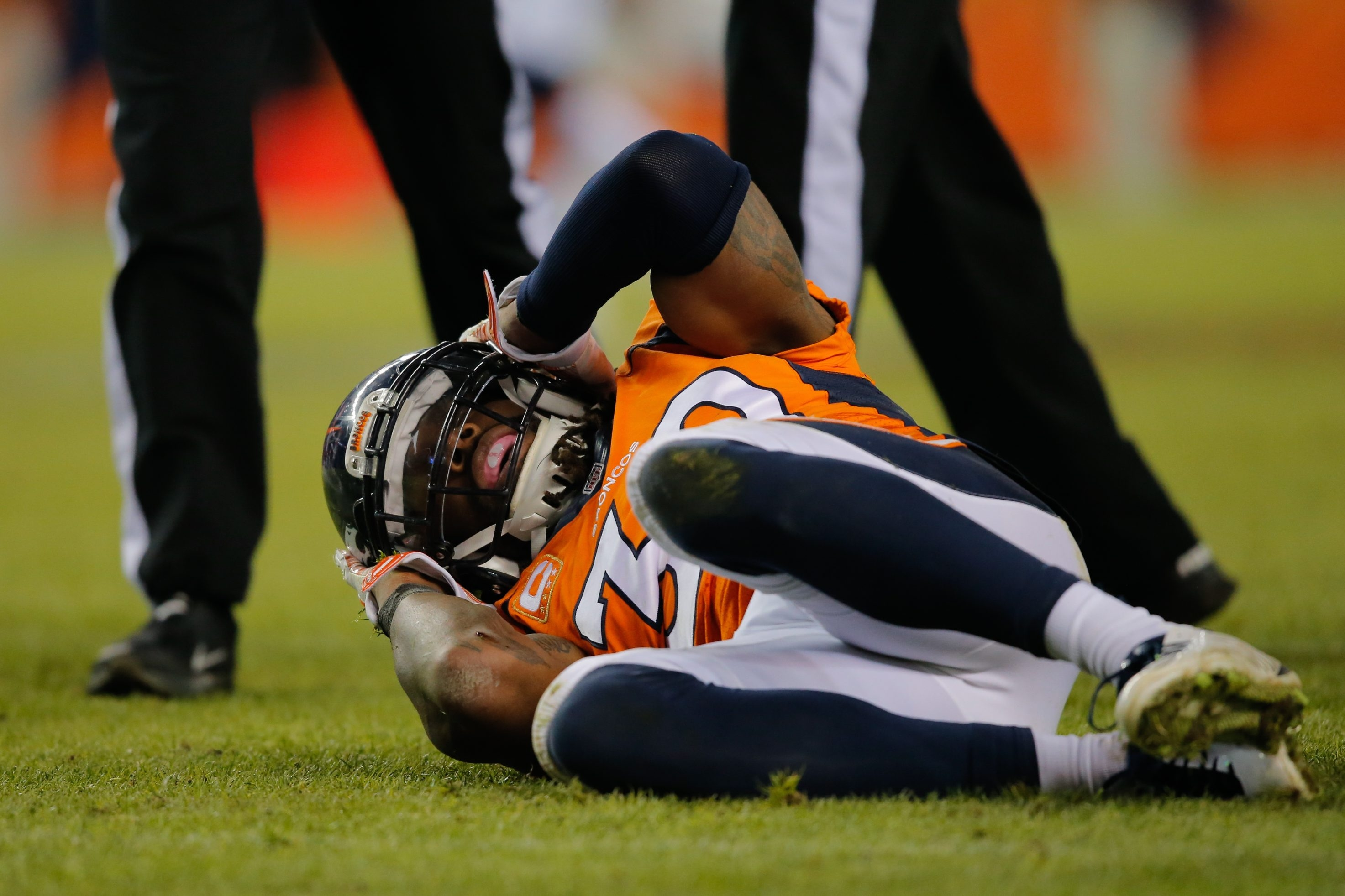 Strong safety David Bruton of the Denver Broncos lies on the ground in pain after a play that would force him out of the game with a reported concussion in 2014.
