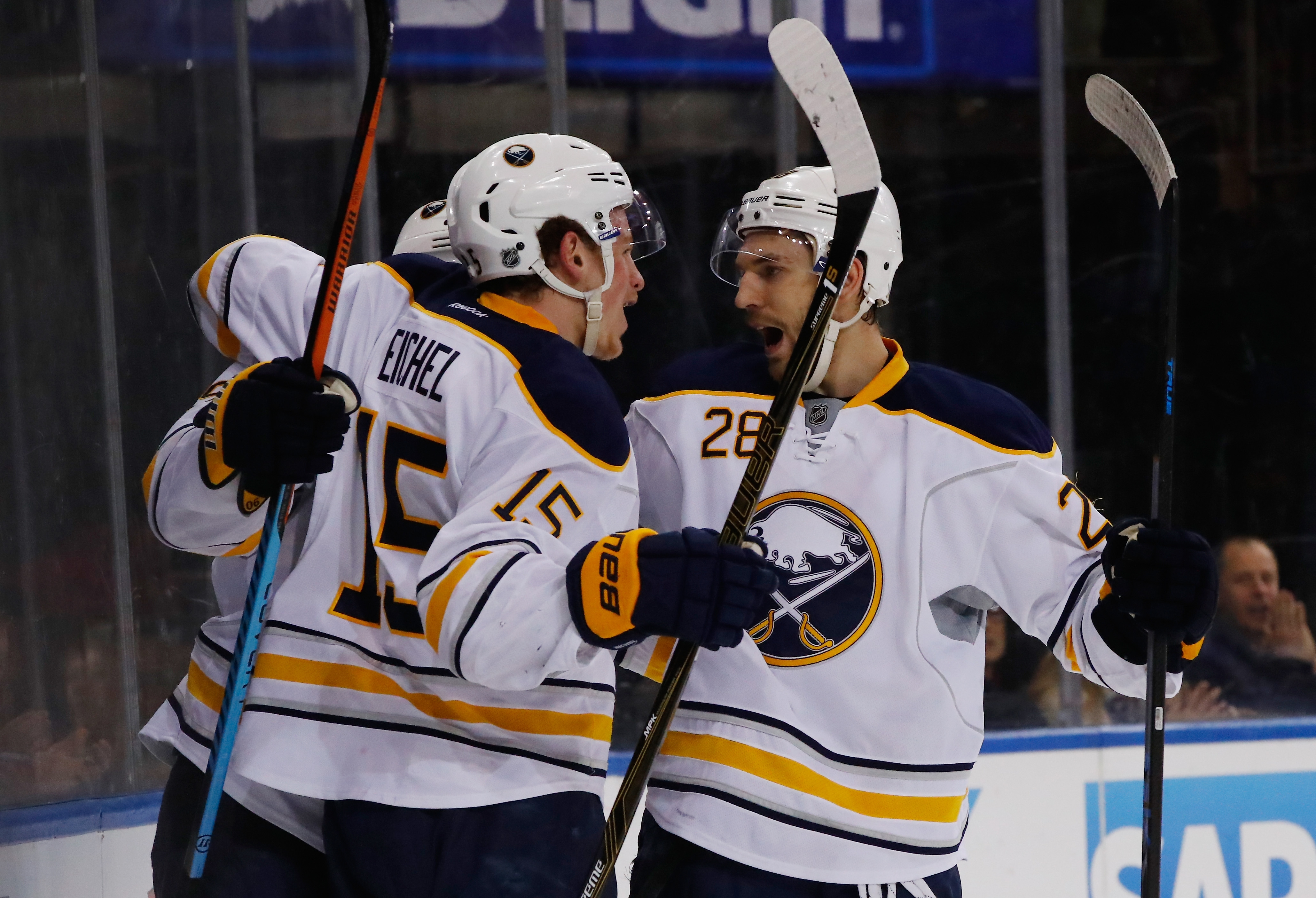 Jack Eichel of the Buffalo Sabres celebrates his goal with Zemgus Girgensons against the New York Rangers during their game at Madison Square Garden on Saturday in New York City.
