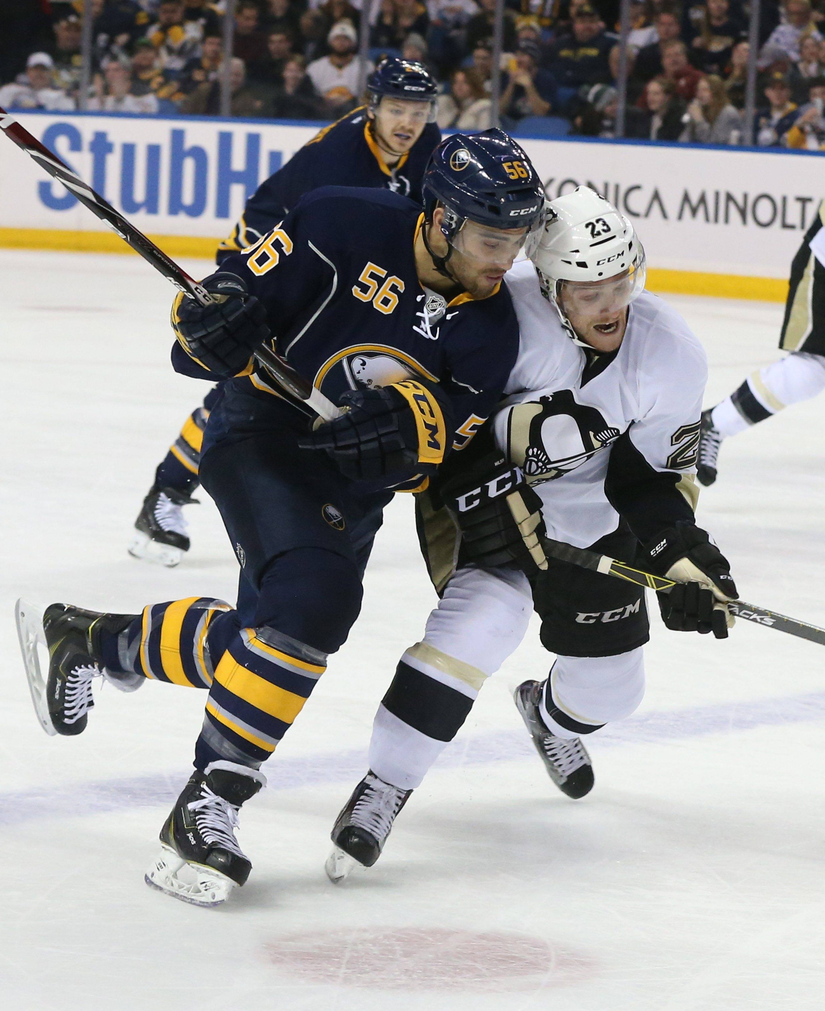 2 lie ncut Buffalo Sabres right wing Justin Bailey (56) battles Pittsburgh Penguins center Scott Wilson (23) for the puck in the first period at First Niagara Center in Buffalo,NY on Sunday, Feb. 21, 2016.  (James P. McCoy/ Buffalo News)