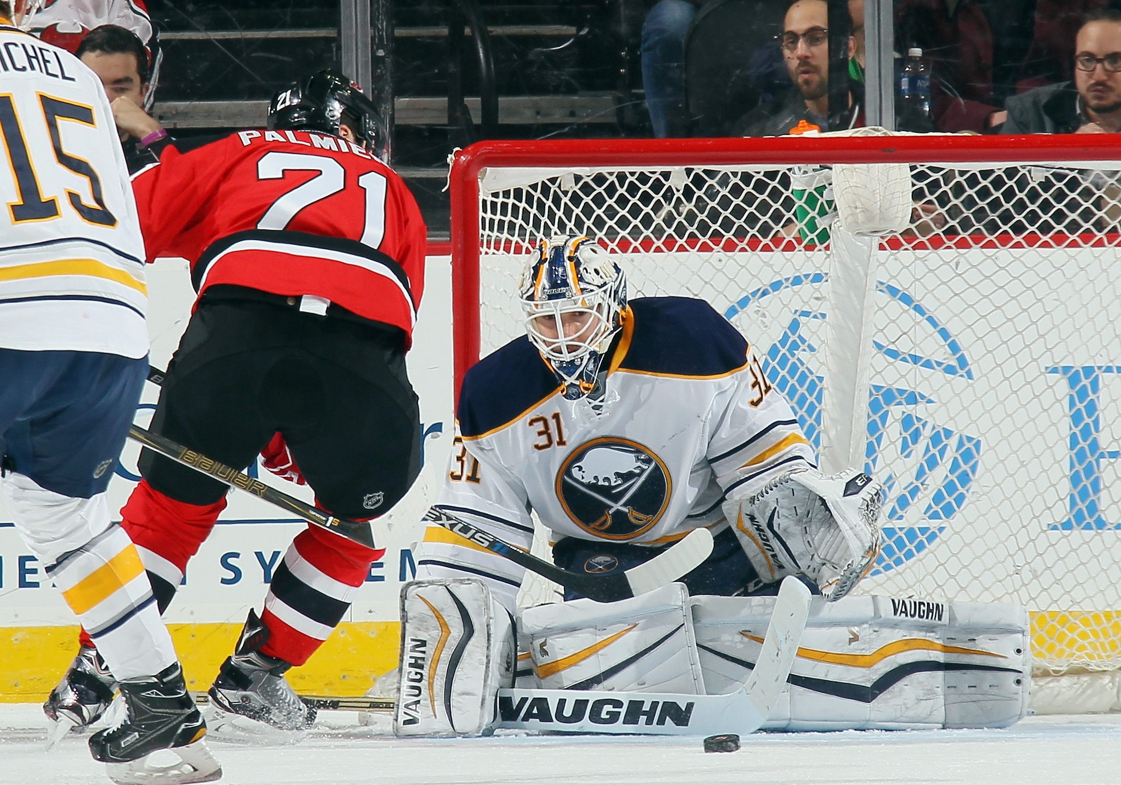Buffalo's Chad Johnson makes a first-period save on Kyle Palmieri.