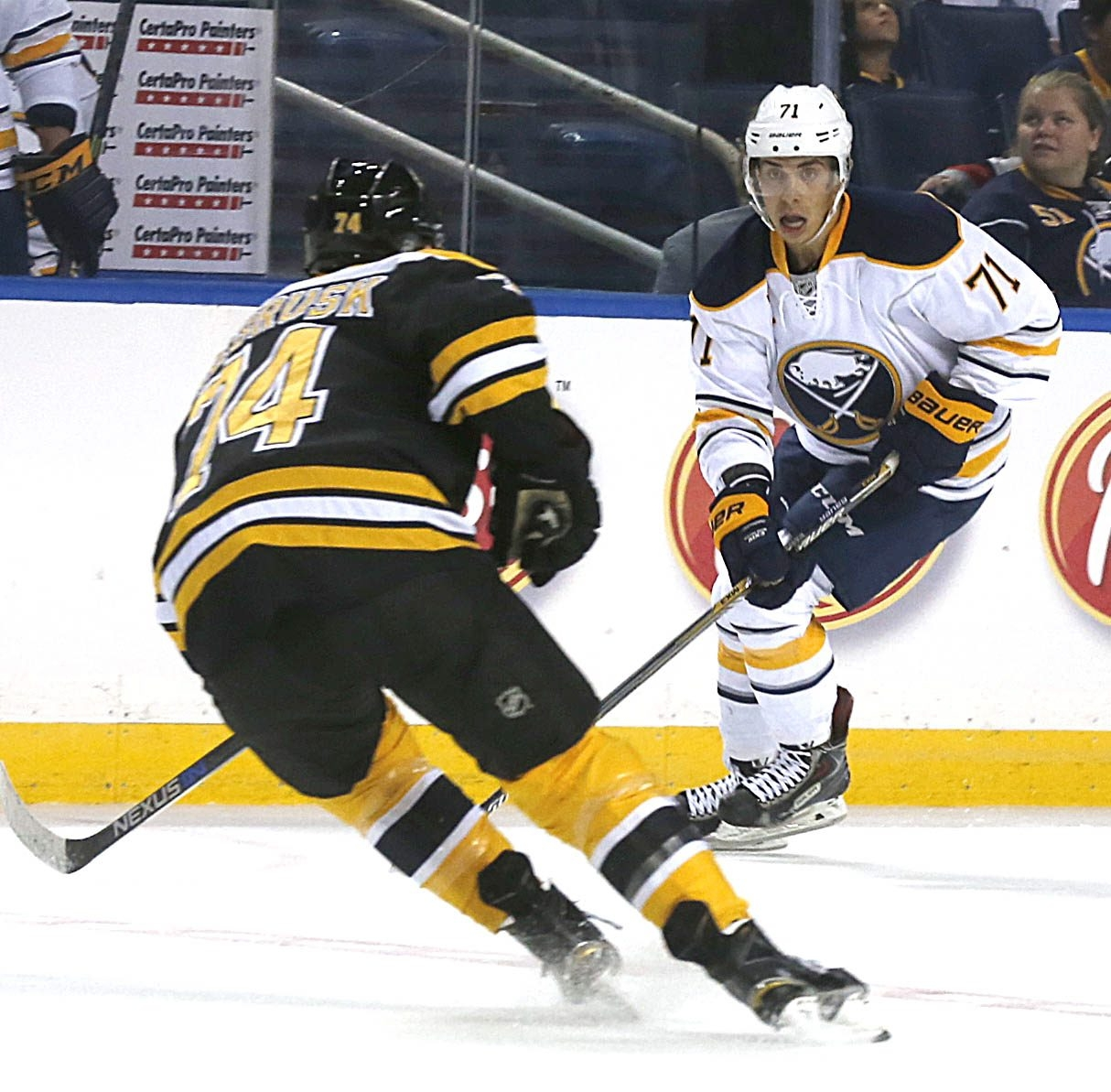 Evan Rodrigues, squares off vs. Boston's Jake DeBrusk, left,  during the game vs. Boston at FNC on Monday, Sept. 14, 2015.  (Robert Kirkham/Buffalo News)