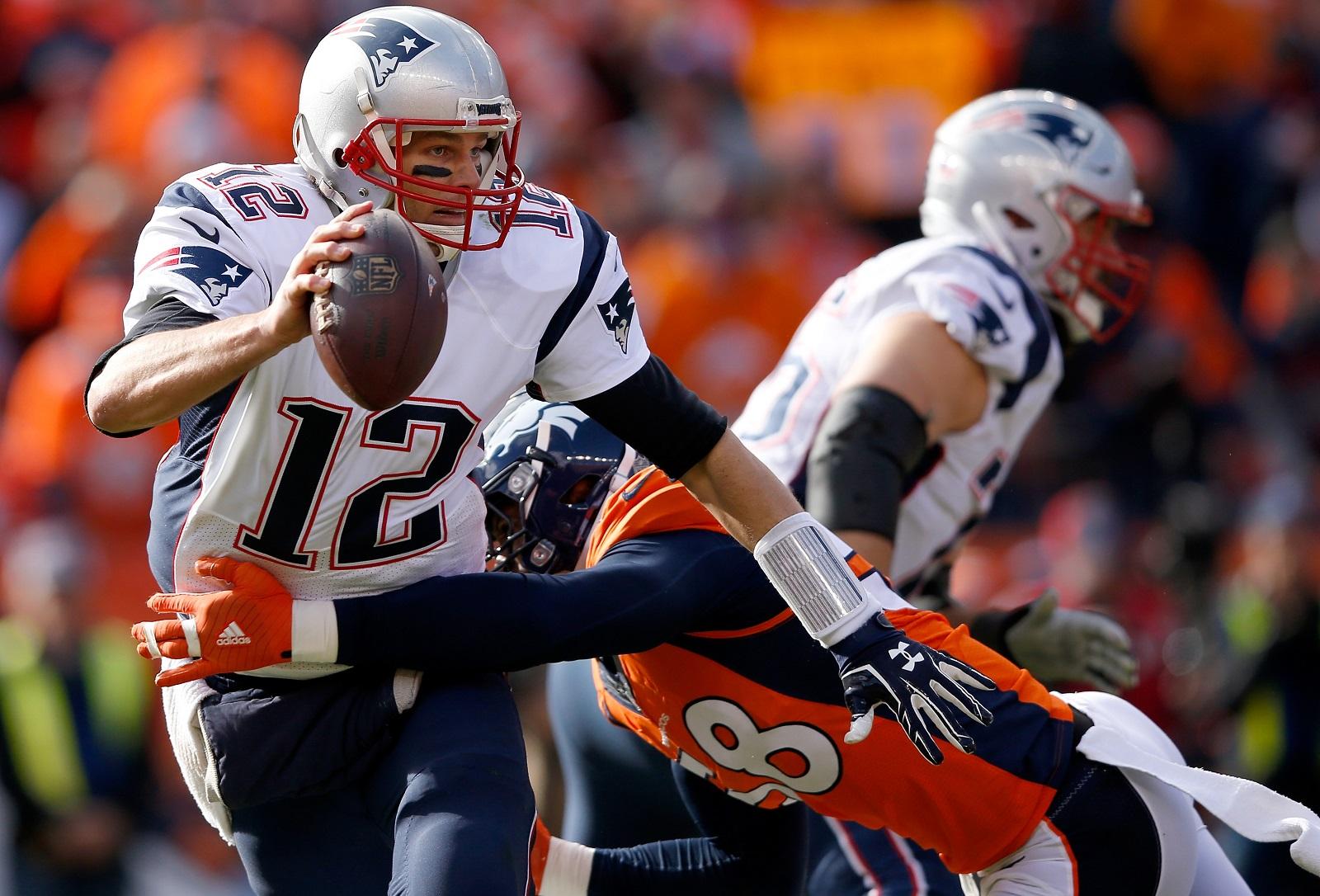 Von Miller, No. 58 in orange, was the Super Bowl MVP. (Photo by Ezra Shaw/Getty Images)
