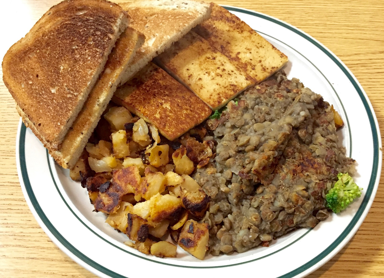 Lentils with broccoli, home fries, rye toast and tofu sizzle strips from Amy's Place ($4.25, early-bird special). (Alex Mikol/Special to The News)