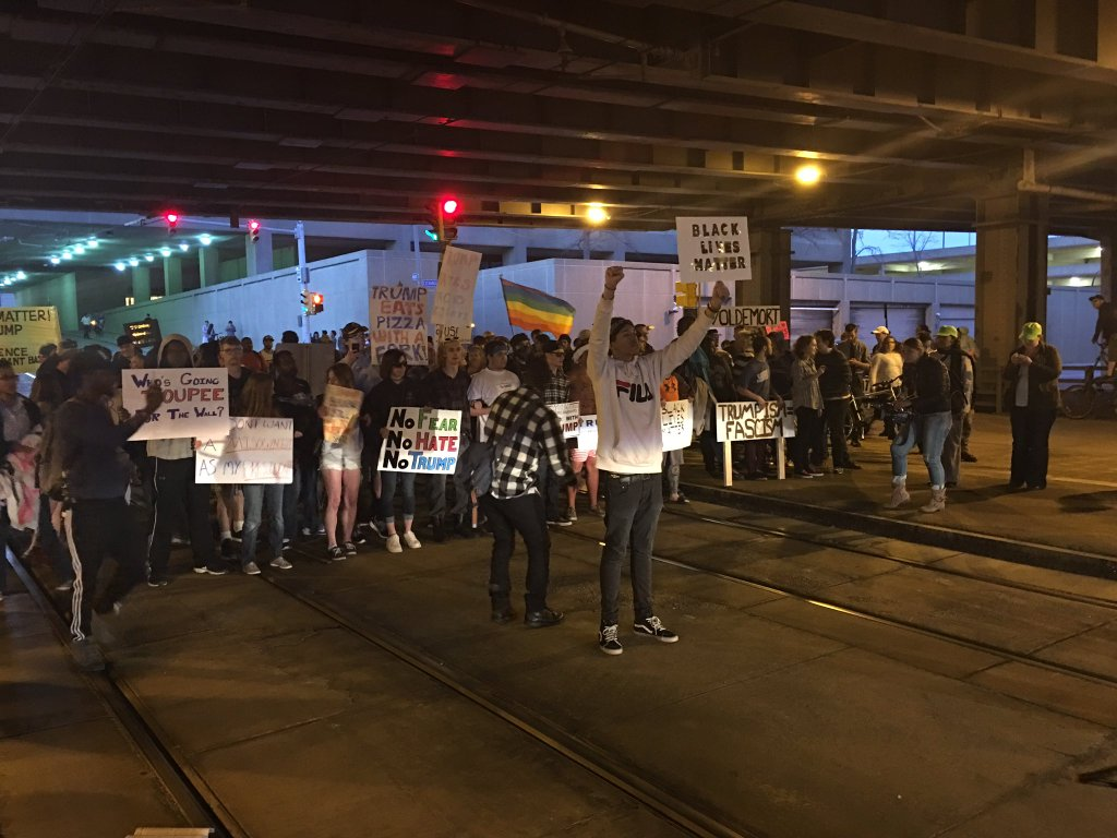 Protesters temporarily blocked Main Street to Metro Rail traffic. (Michael Canfield/Buffalo News)