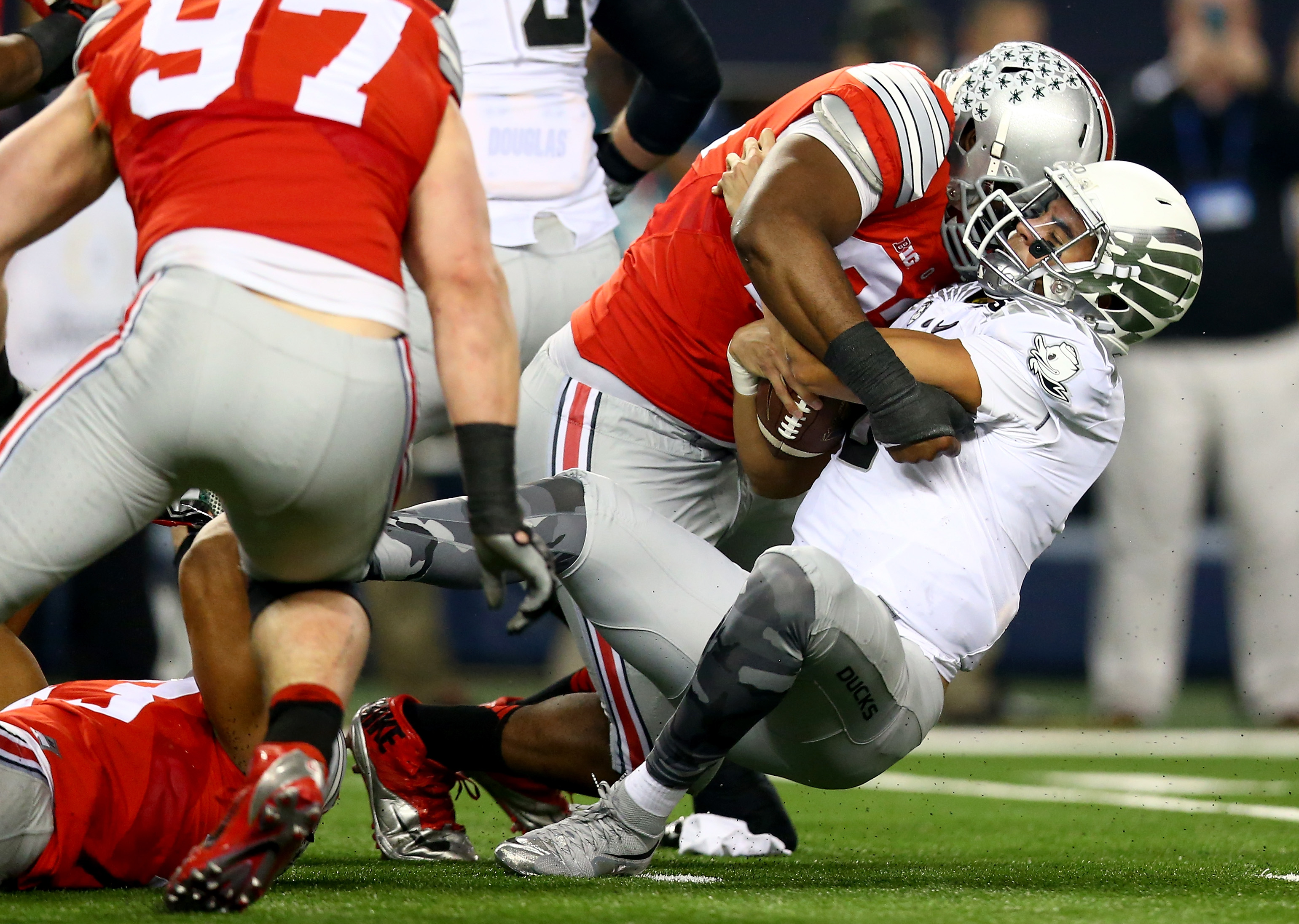 Defensive lineman Adolphus Washington of Ohio State sacks Marcus Mariota of Oregon in the second quarter during the 2015 College Football Playoff National Championship Game.  (Getty Images)