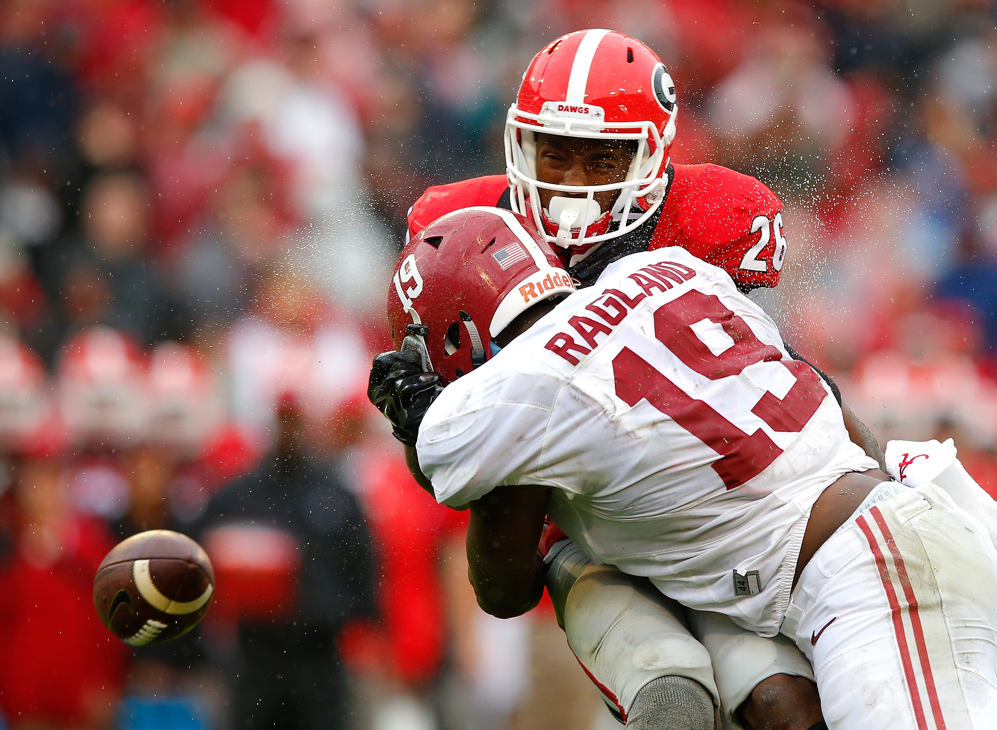 ATHENS, GA - OCTOBER 03:  Reggie Ragland #19 of the Alabama Crimson Tide breaks up a reception as he tackles Malcolm Mitchell #26 of the Georgia Bulldogs at Sanford Stadium on October 3, 2015 in Athens, Georgia.  (Photo by Kevin C. Cox/Getty Images)