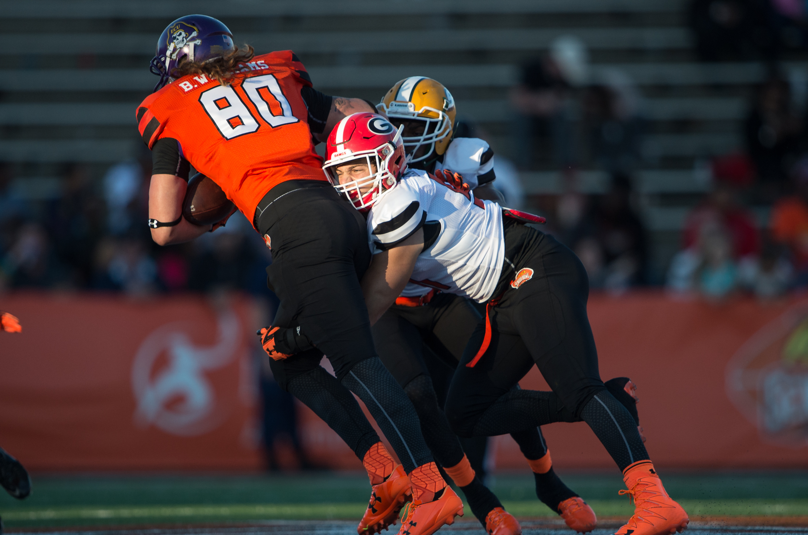MOBILE, AL - JANUARY 30: South team's inside line backer Jake Ganus #51 with Georgia looks to tackle North team's tightend Bryce Williams #80 with East Carolina on January 30, 2016 at Ladd-Peebles Stadium in Mobile, Alabama. (Photo by Michael Chang/Getty Images)