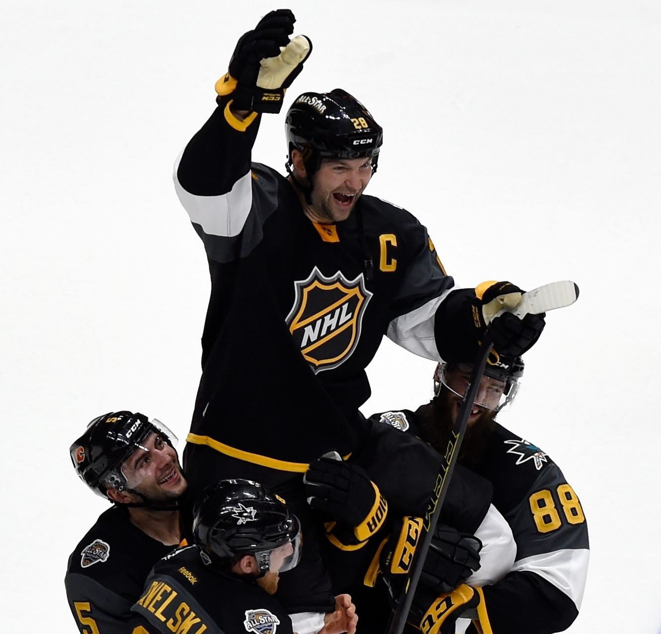John Scott's teammates carry him off the ice after their team won the NHL All-Star Game on Jan. 31. (Getty Images)