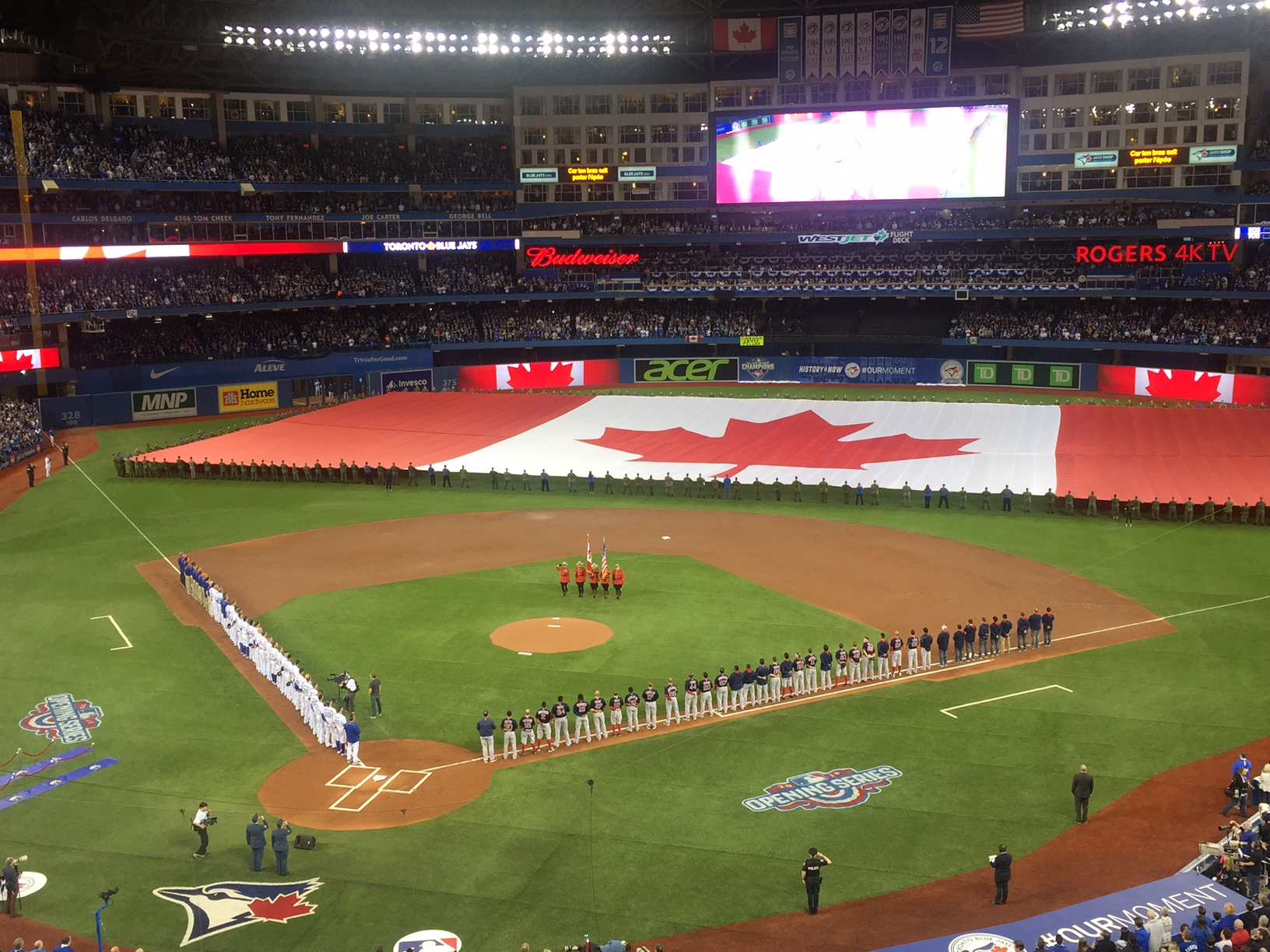 The Rogers Centre, home of the Toronto Blue Jays, is decked out during the playing of O, Canada during Friday night's home opener vs. the Red Sox (Mike Harrington/Buffalo News).